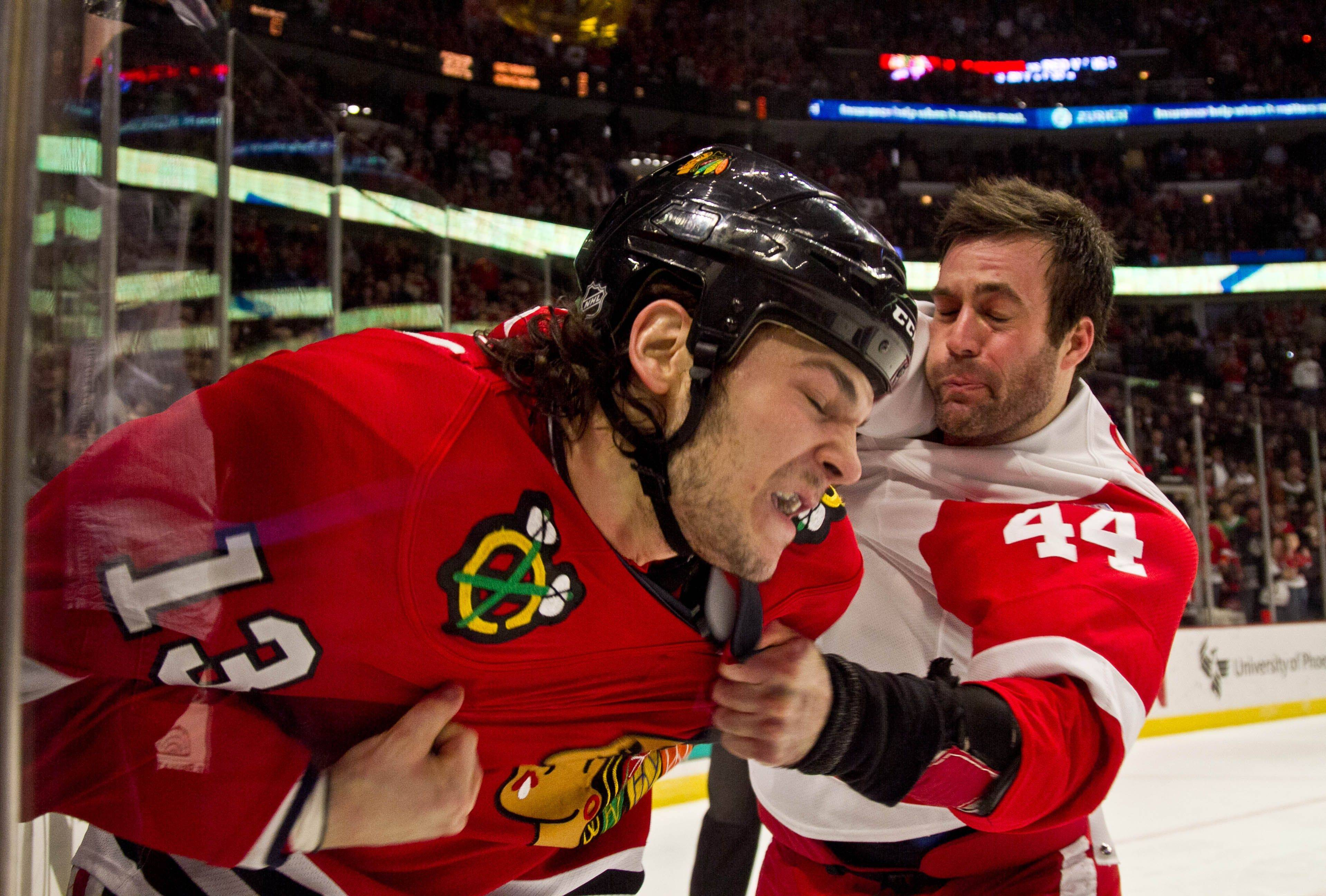 Chicago Blackhawks' Daniel Carcillo and Detroit Red Wings' Todd Bertuzzi fight during the first period of an NHL hockey game in Chicago, Friday, Dec. 30, 2011.