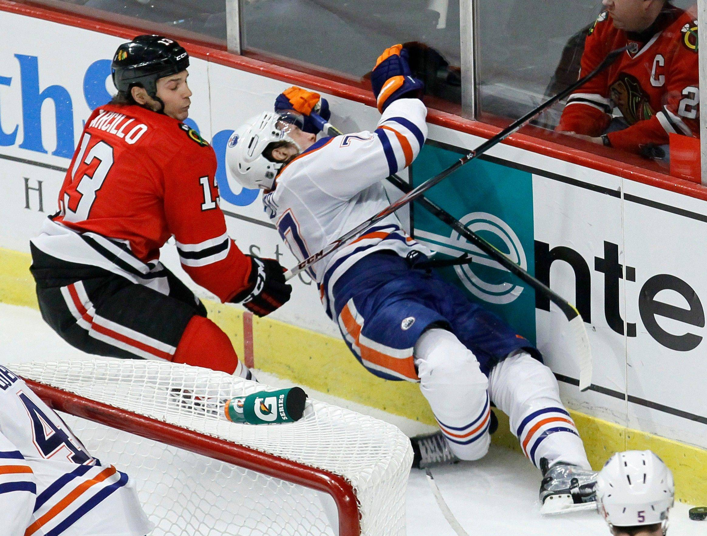 This hit by Daniel Carcillo against Edmonton's Tom Gilbert ended up getting Carcillo a seven-game suspension, as well as ending the Hawks' winger's season.