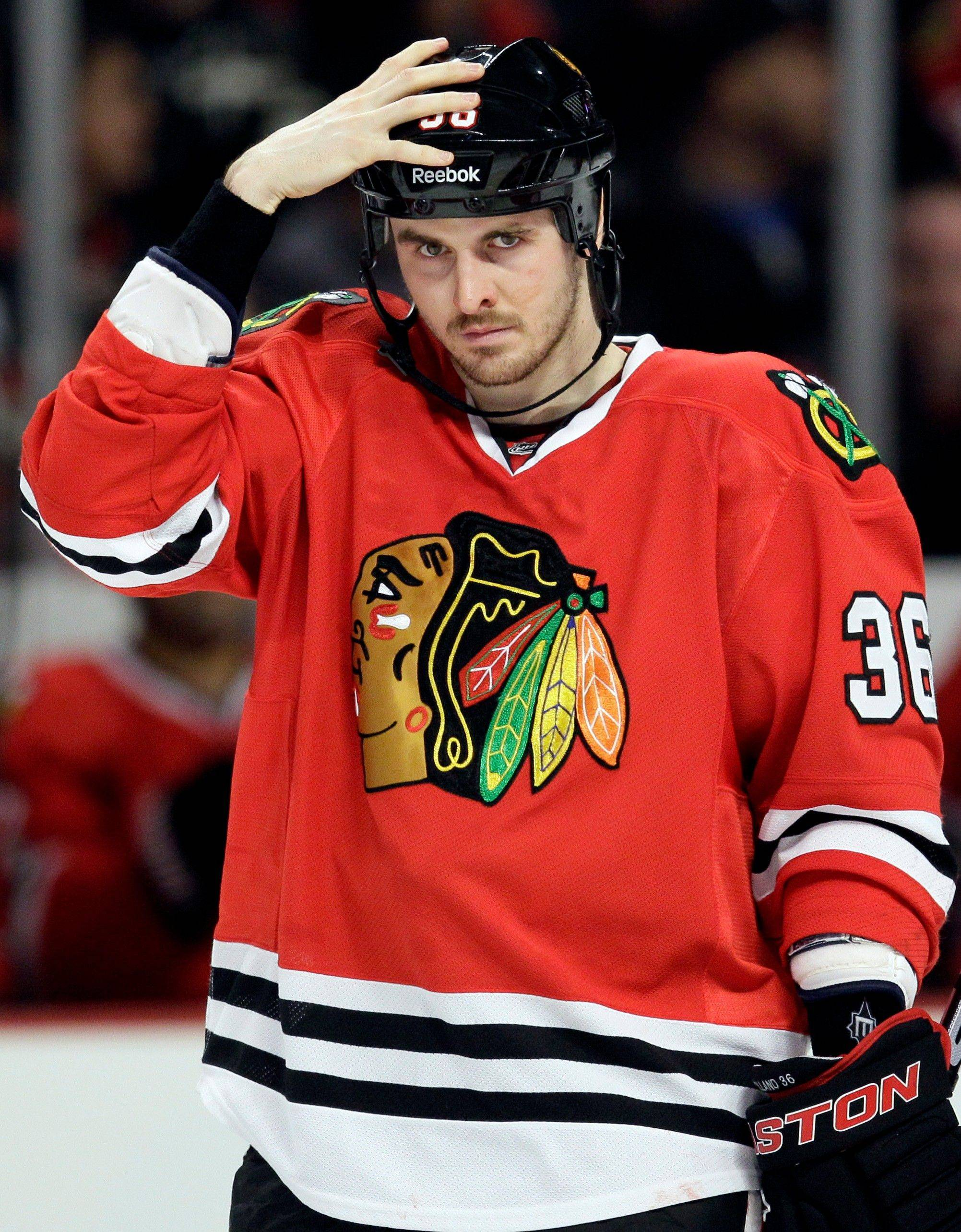 Blackhawks' Dave Bolland (36) checks his helmet during the third period of an NHL hockey game against the Colorado Avalanche in Chicago, Friday, Jan. 6, 2012. The Avalanche won 4-0.