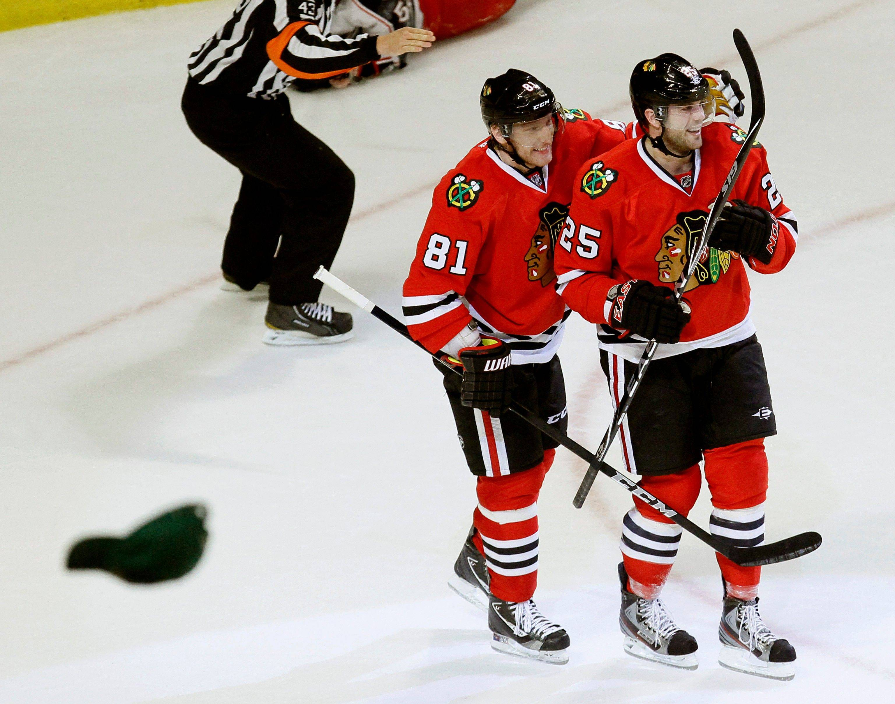 Blackhawks left wing Viktor Stalberg (25) celebrates his hat trick with teammate Marian Hossa, during the third period of an NHL hockey game against the Columbus Blue Jackets, Tuesday, Jan. 10, 2012, in Chicago. The Blackhawks won 5-2.