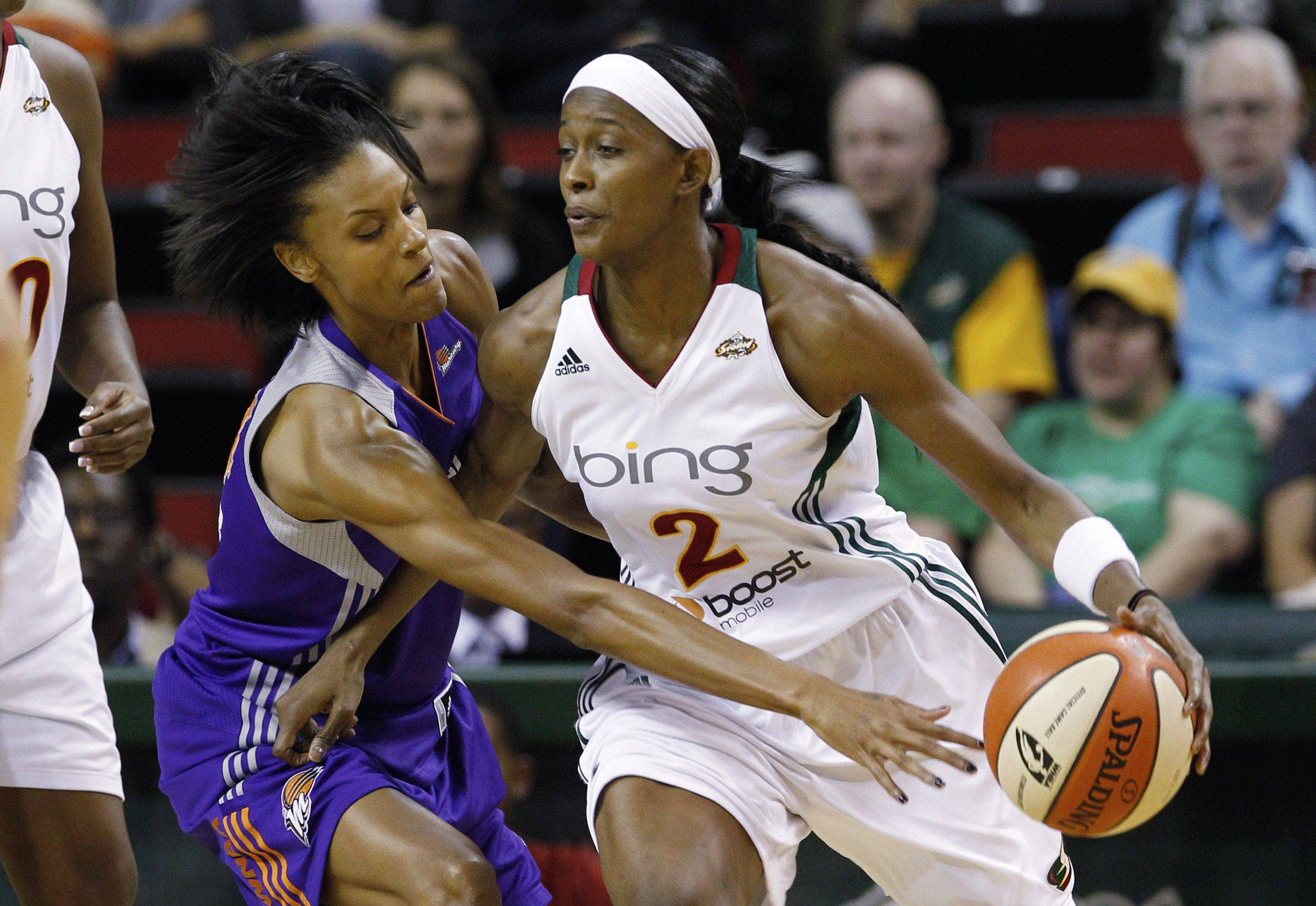 Phoenix Mercury's DeWanna Bonner, left, reaches across Seattle Storm's Swin Cash during the first half of Game 1 of a first-round WNBA playoff basketball series Thursday, Sept. 15, 2011, in Seattle.