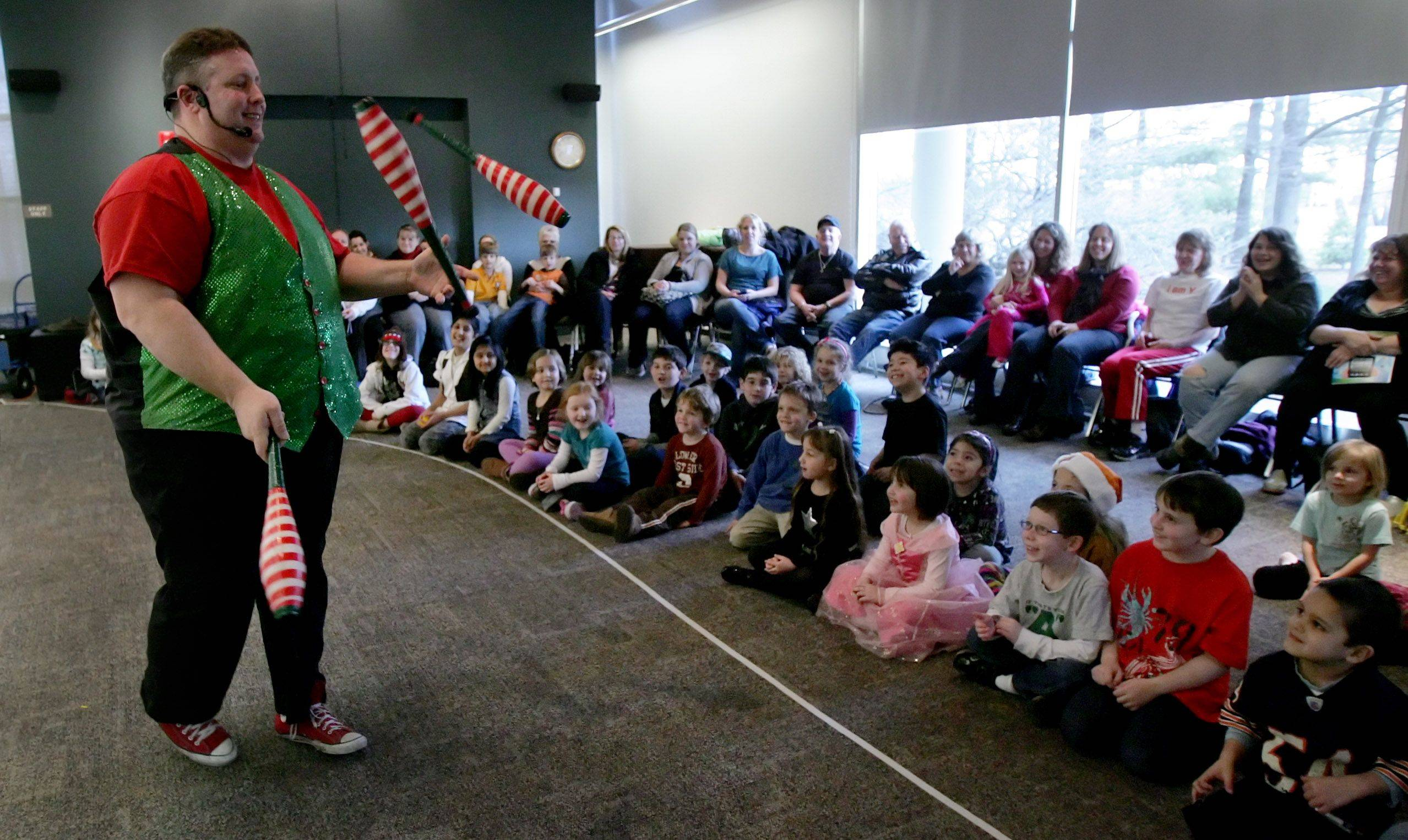 """The Flying Fool"" Ken Schultz juggles as he entertains children and adults with stunts, juggling and balloon animals at the Wauconda Area Library."