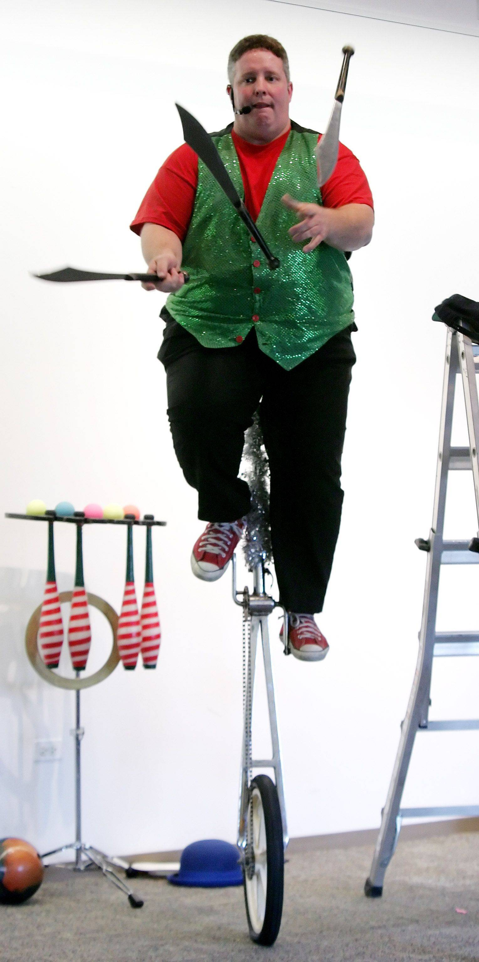 """The Flying Fool"" Ken Schultz balances on a five-foot unicycle as he juggles three swords."