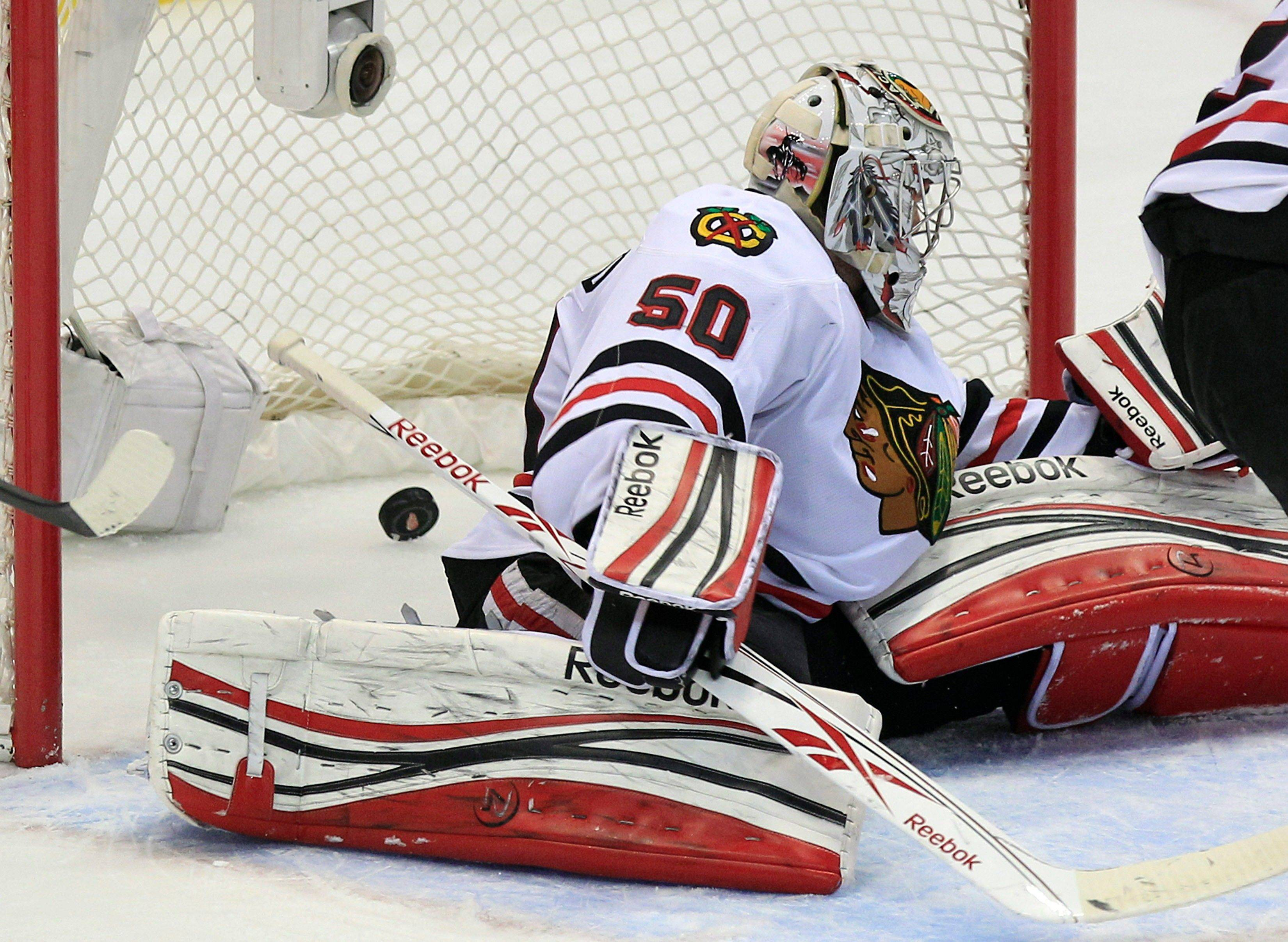 Blackhawks goalie Corey Crawford stretches but fails to block the game-winning goal by Detroit's Todd Bertuzzi during the overtime period. Crawford actually was the star of the game for the Hawks, keeping them in the game in the first period.