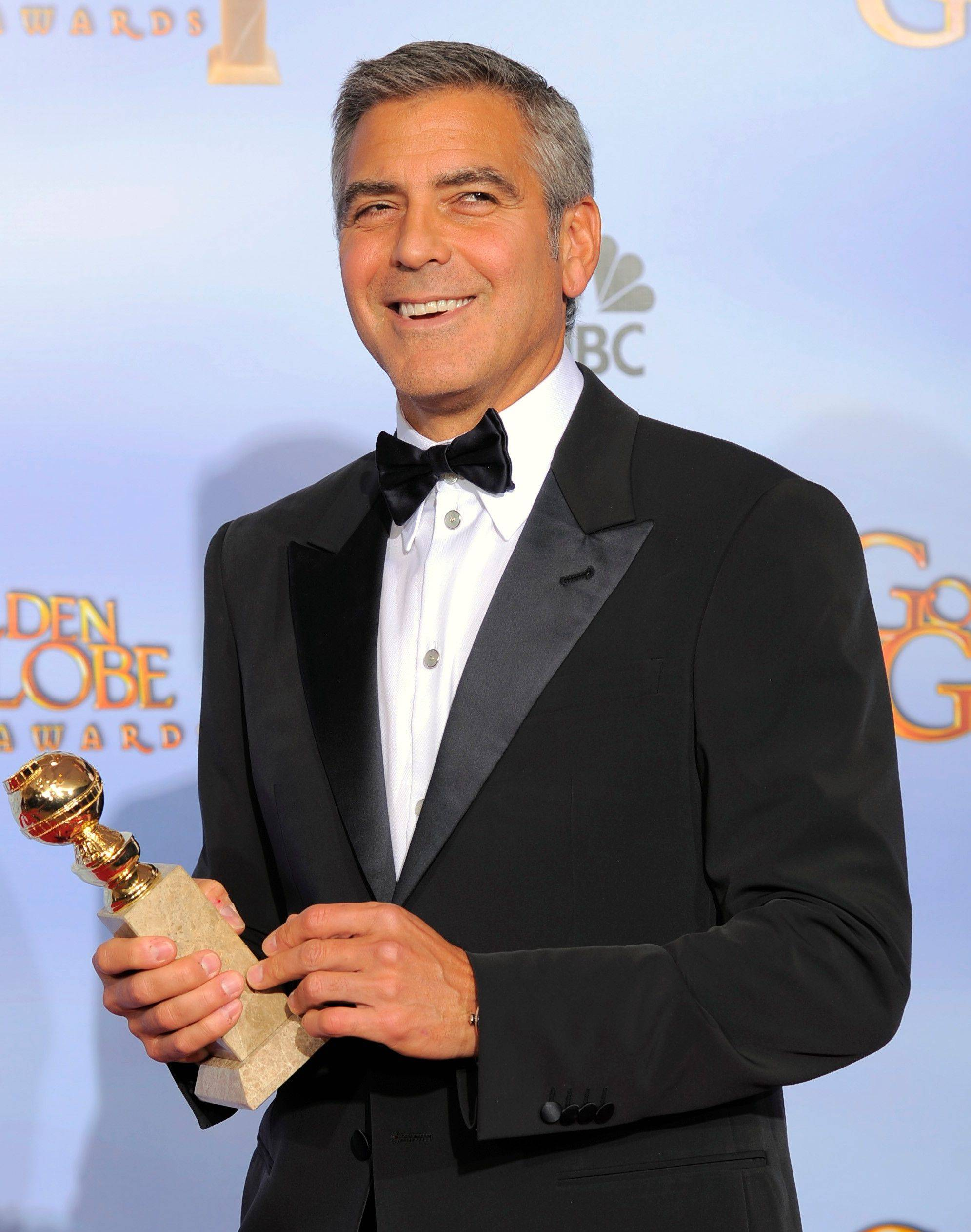 "Actor George Clooney poses backstage with the award for Best Actor in a Motion Picture Drama for the film ""The Descendants"" during the 69th Annual Golden Globe Awards Sunday, Jan. 15, 2012, in Los Angeles. ("