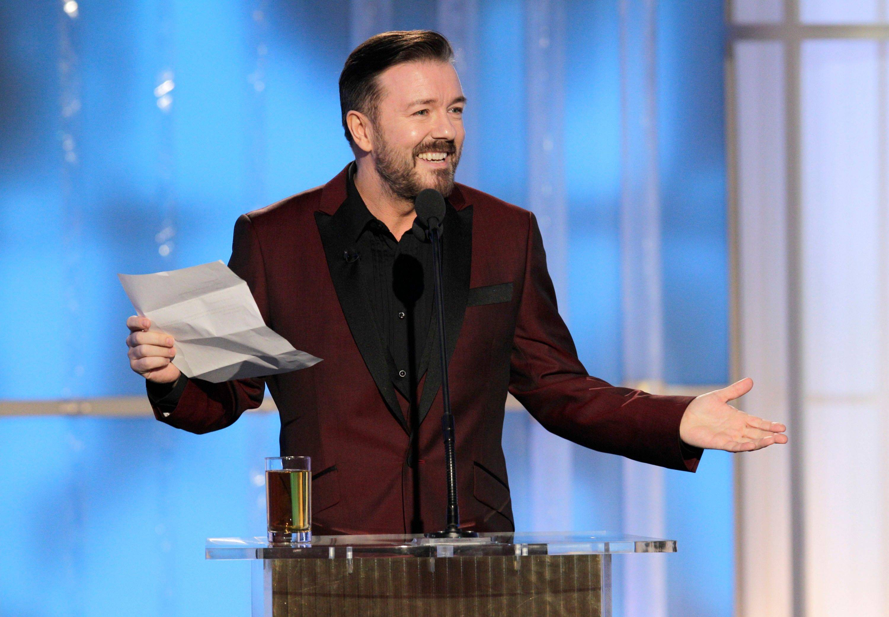 In this image released by NBC, host Ricky Gervais speaks during the 69th Annual Golden Globe Awards, Sunday, Jan. 15, 2012 in Los Angeles.
