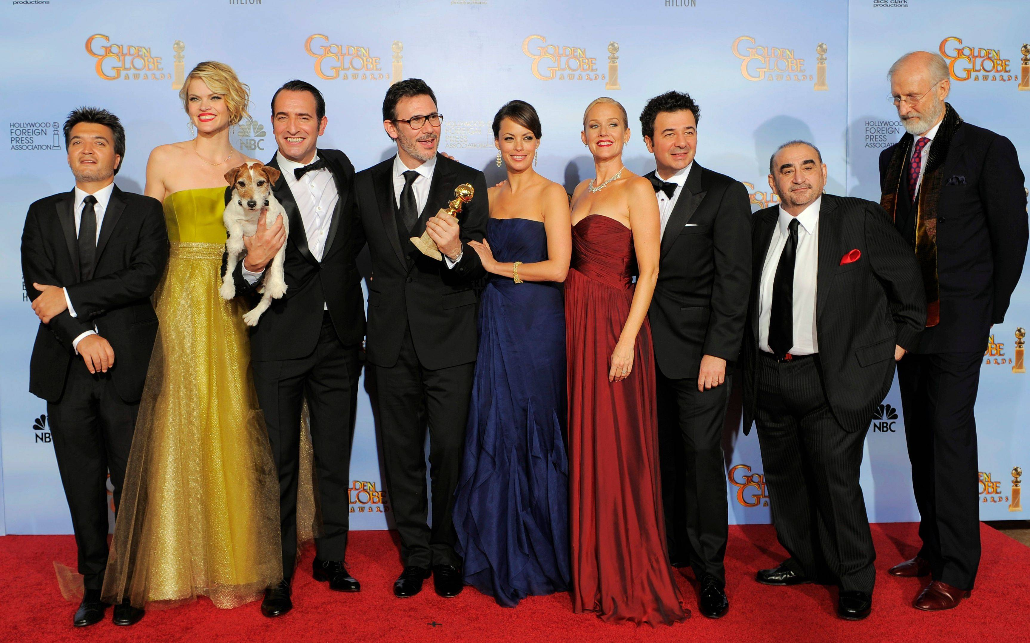 "The cast and crew of the film ""The Artist"" pose backstage Sunday with the award for Best Motion Picture - Comedy or Musical during the 69th Annual Golden Globe Awards. From left, Thomas Langmann, Missy Pyle, Jean Dujardin, Michel Hazanavicius, Berenice Bejo, Penelope Ann Miller, Ludovic Bource, Ken Davitian and James Cromwell."