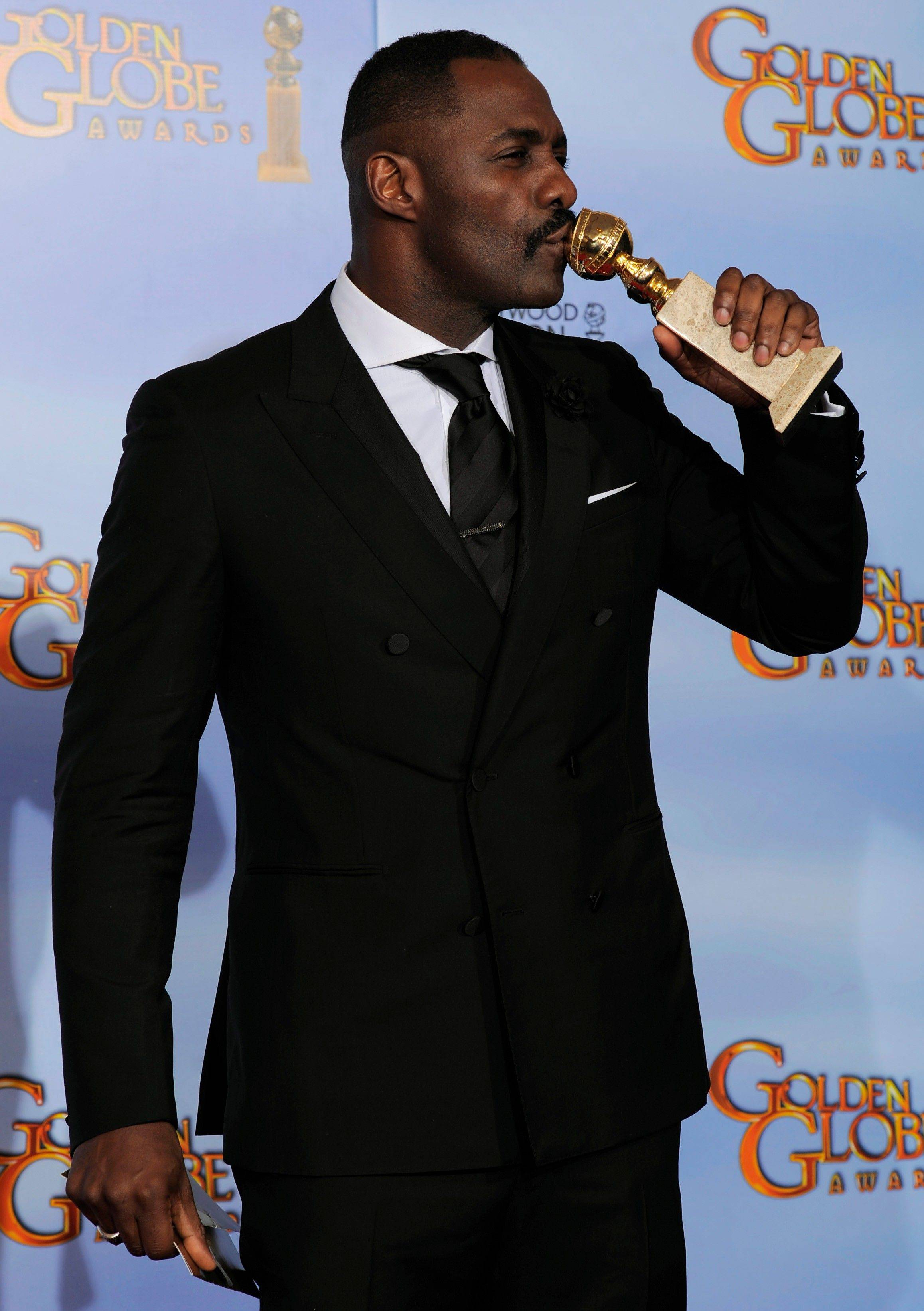 "Idris Elba poses backstage with the award for Best Actor in a Mini-Series or TV Movie for ""Luther"" during the 69th Annual Golden Globe Awards."