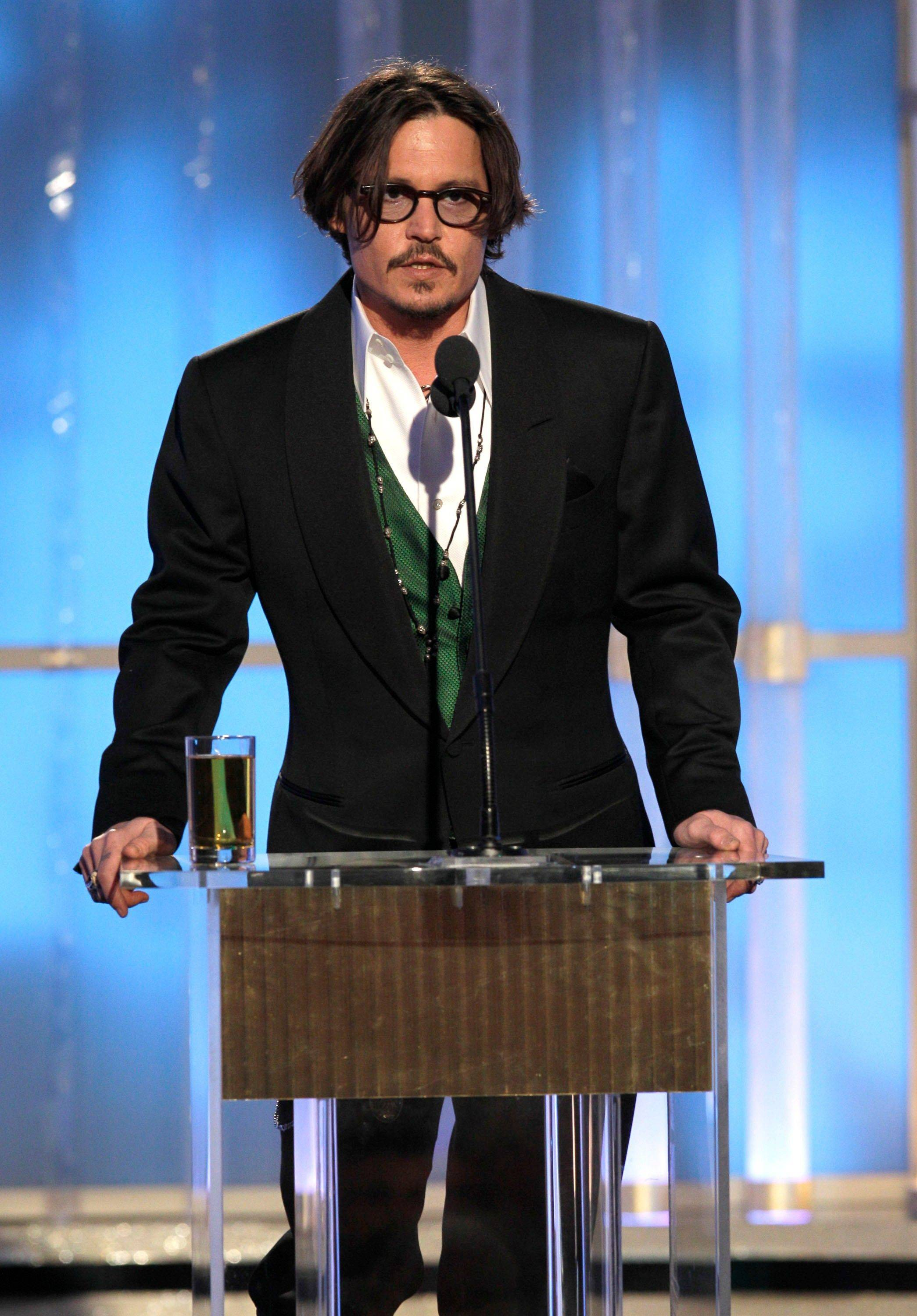 In this image released by NBC, presenter Johnny Depp speaks during the 69th Annual Golden Globe Awards.