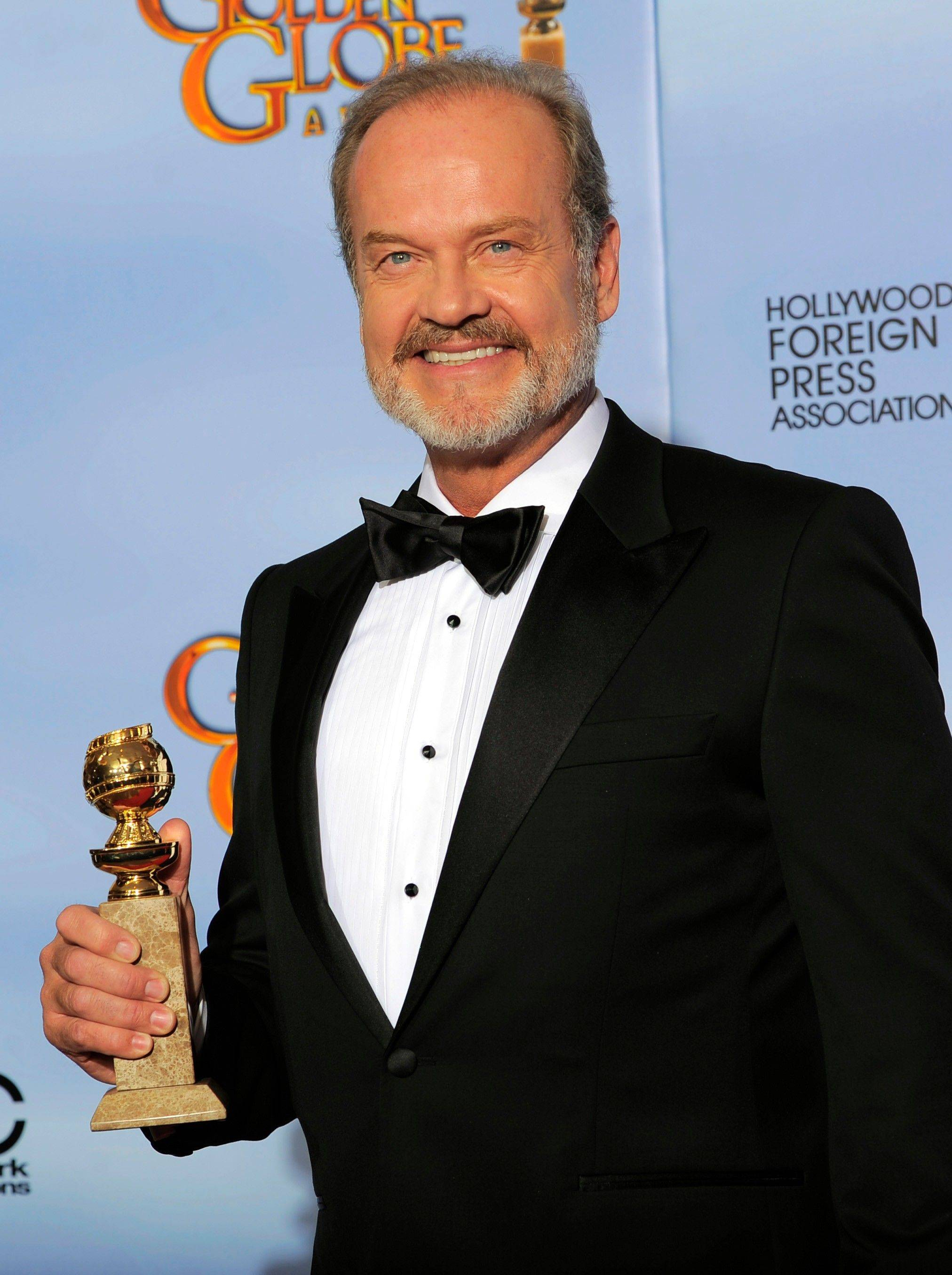 "Actor Kelsey Grammer poses backstage with the award for Best Actor in a TV Series Drama for the series ""Boss"" during the 69th Annual Golden Globe Awards."