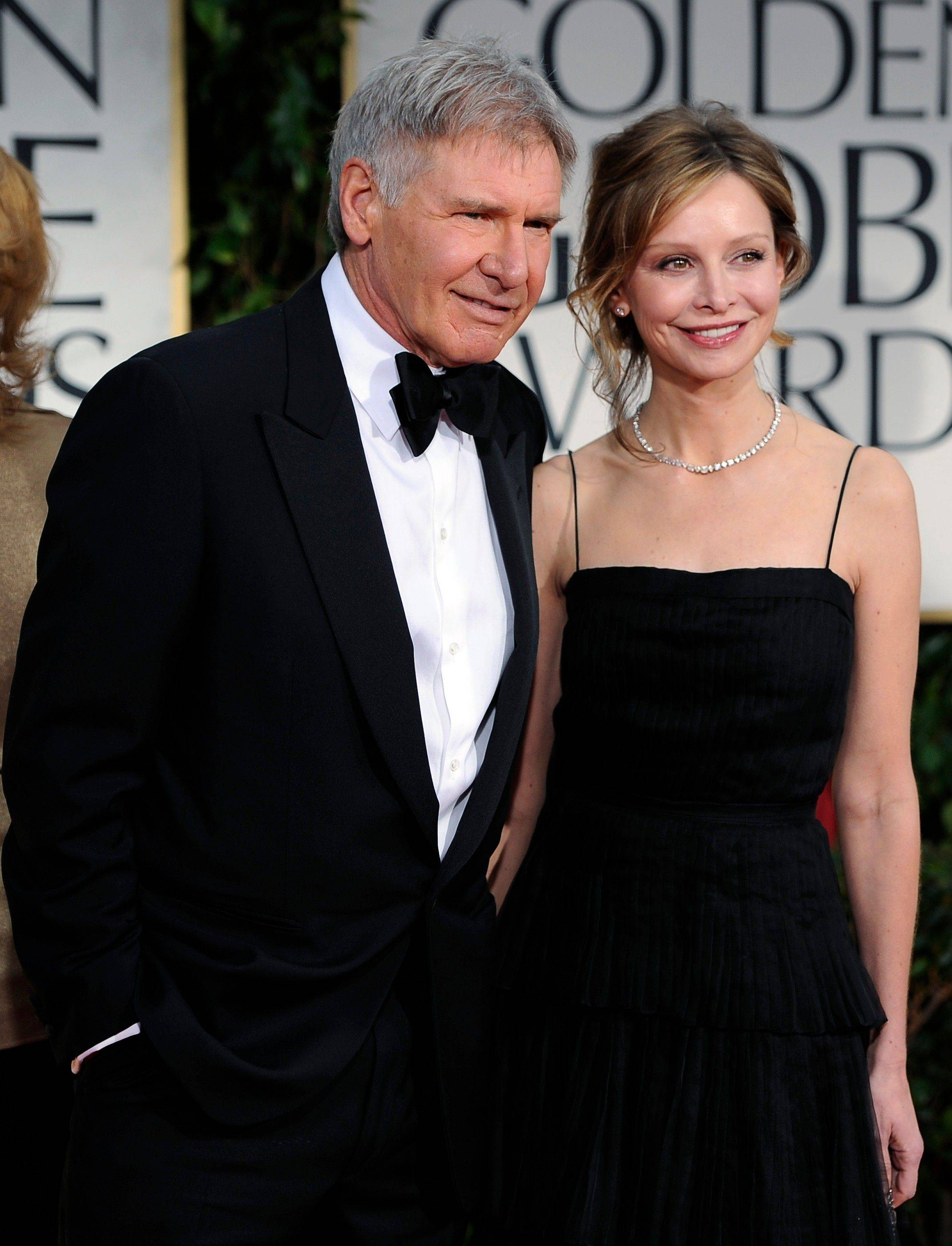 Harrison Ford, left, and Calista Flockhart arrive at the 69th Annual Golden Globe Awards.
