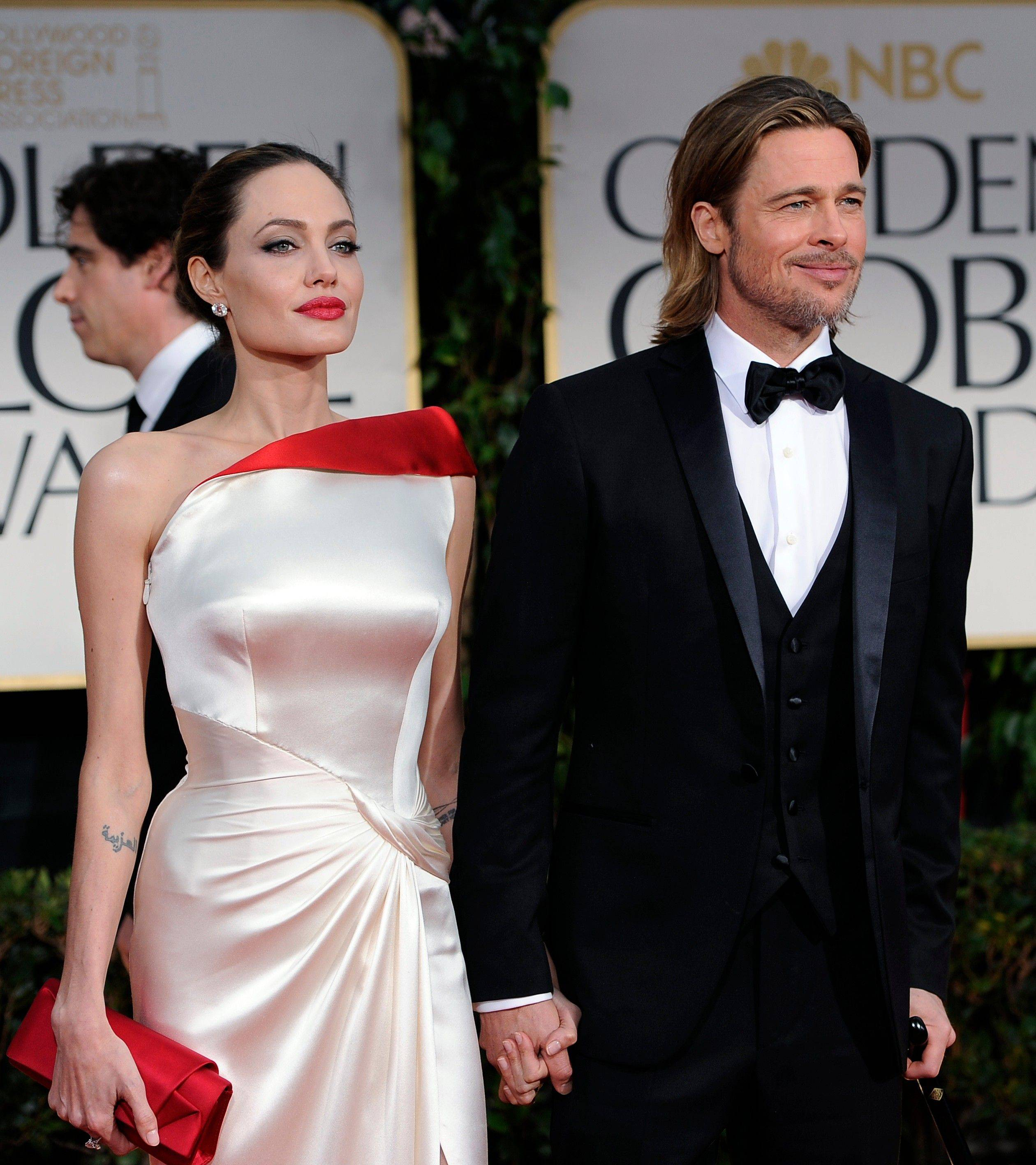 Angelina Jolie and Brad Pitt arrive at the 69th Annual Golden Globe Awards.