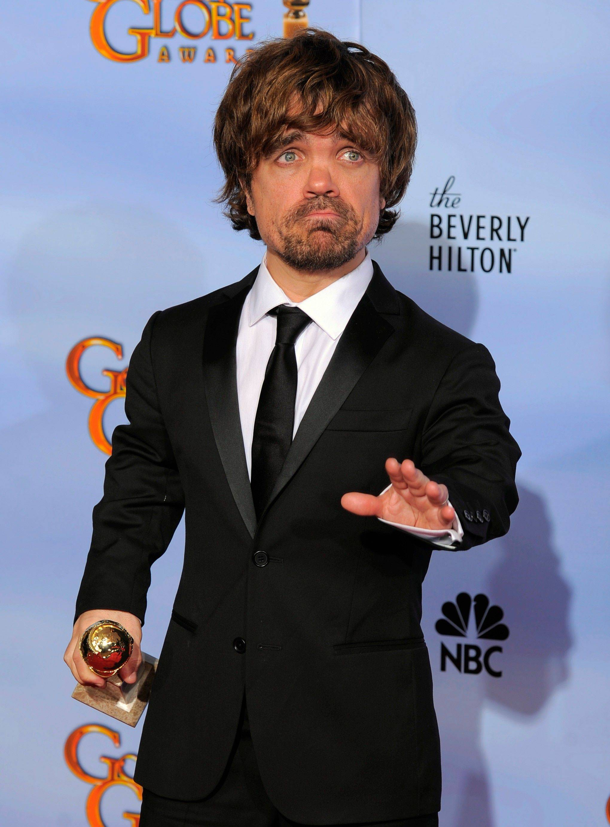 "Actor Peter Dinklage poses backstage with the award for Best Supporting Actor in a Series, Mini Series or TV Movie for ""Game of Thrones"" during the 69th Annual Golden Globe Awards Sunday."