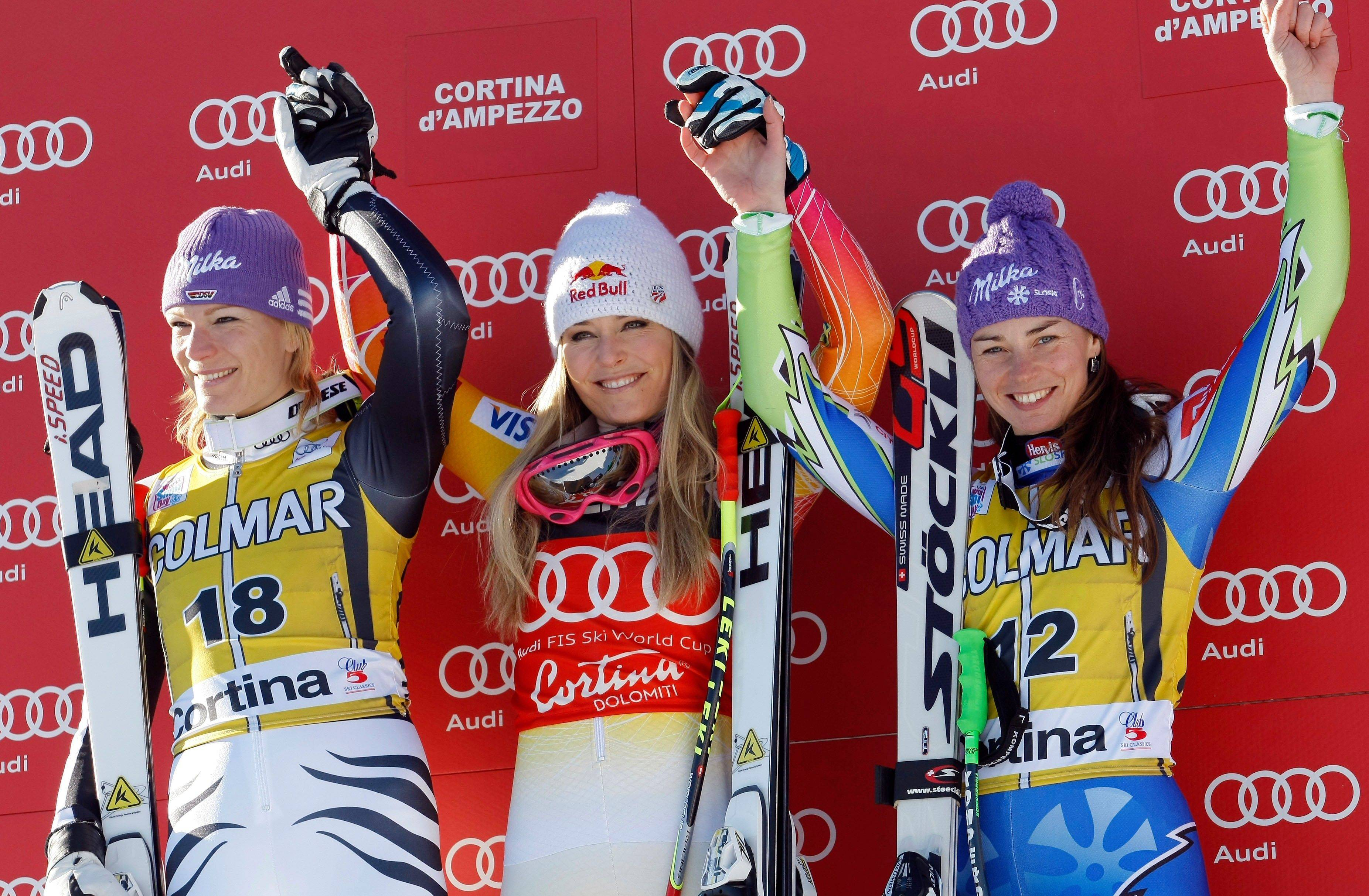 Super-G champion Lindsey Vonn of the United States, center, celebrates on the podium Sunday with second-place winner Maria Hoefl-Riesch of Germany, left, and third-place winner Tina Maze of Slovenia in Cortina D'Ampezzo, Italy.