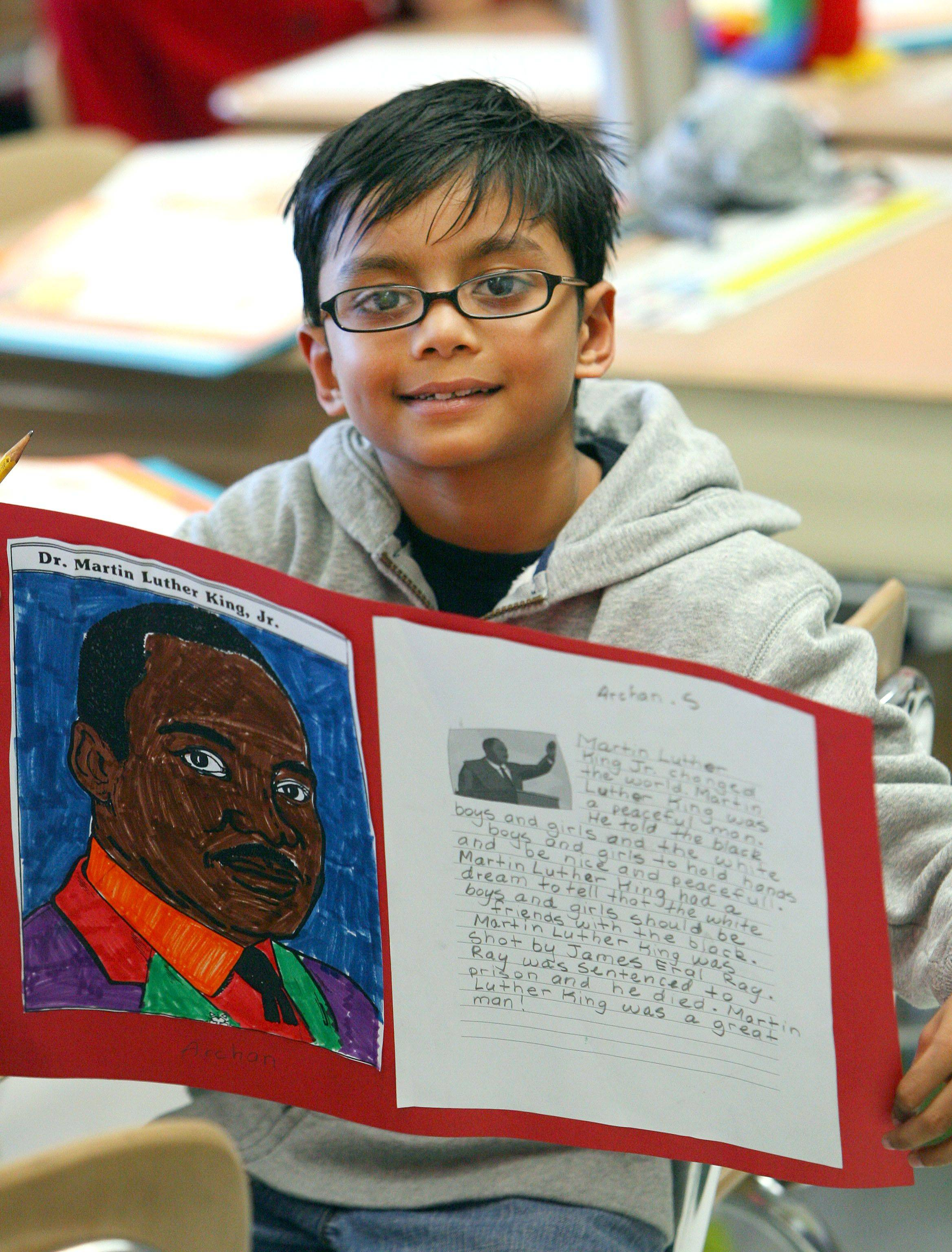 Archan Sriselvakumar, 7, of Grayslake holds up his project on Martin Luther King Jr. at Woodland Elementary West in Gages Lake. Second-grade students in Nancy Constant's class read books and wrote essays about how Martin Luther King changed the world.