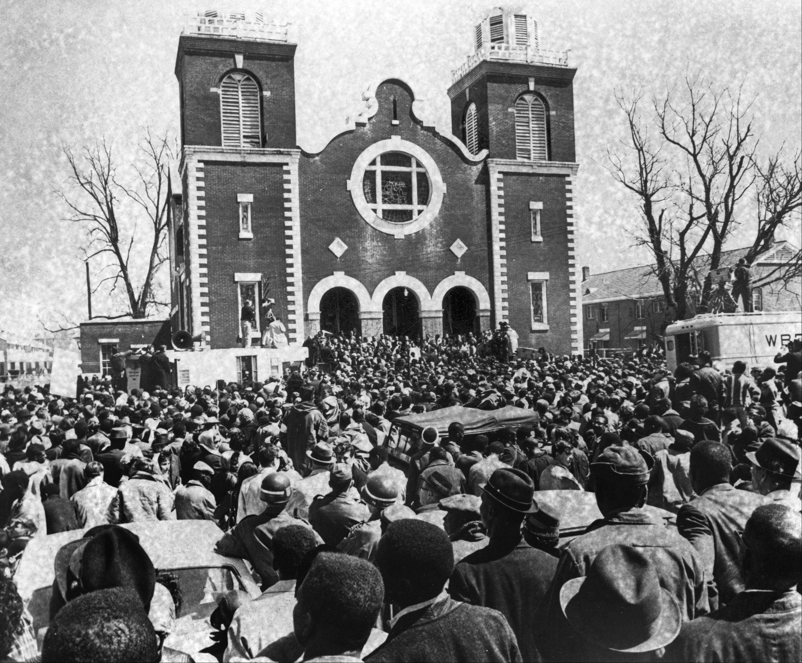 Thousands of civil rights supporters gather outside a chapel in Selma, Ala., on March 21, 1965, the start of a five-day, fifty-mile march on the Alabama state Capitol at Montgomery. The march will be led by the Reverend Dr. Martin Luther King, who spoke at this church service preceding the march. Supporters of black voting rights will march from Selma to Montgomery to protest the killing of a demonstrator by a state trooper and to improve voter registration for blacks, who are discouraged to register.