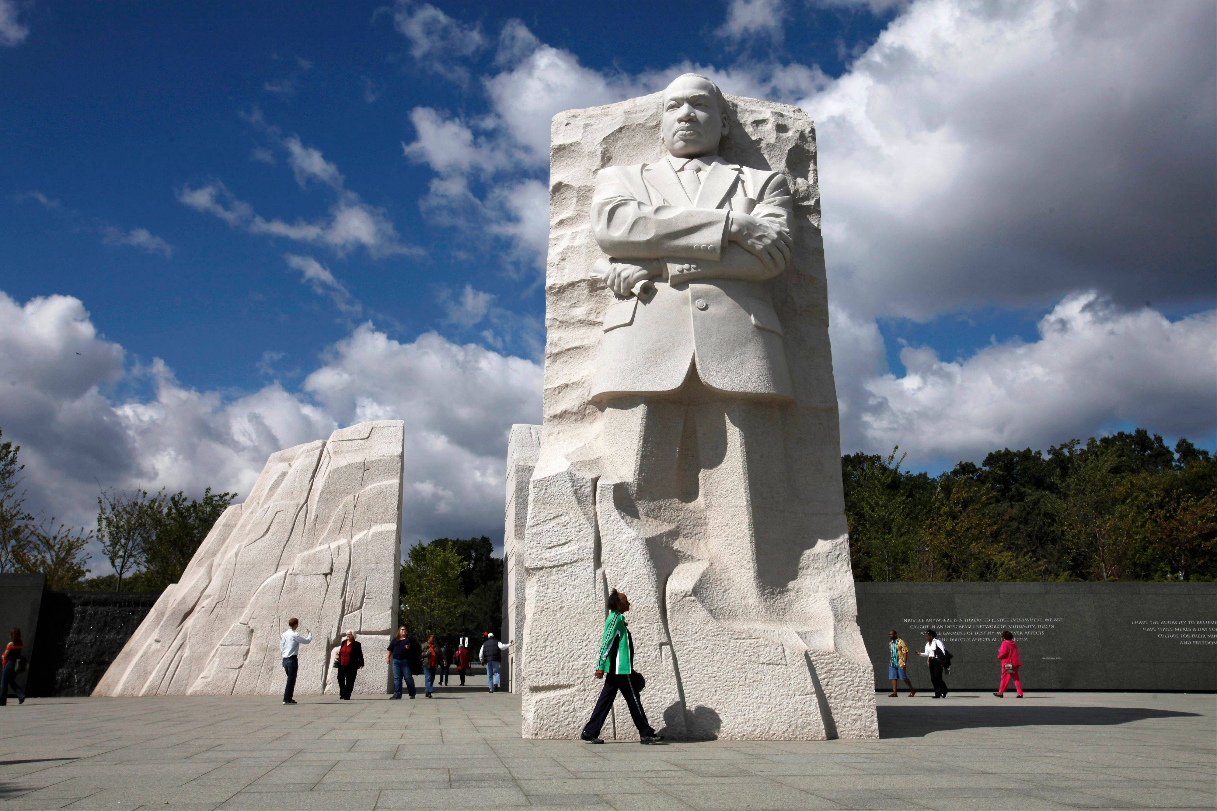 A visitor walks through the Martin Luther King, Jr. Memorial in Washington, Tuesday, Oct. 4, 2011.