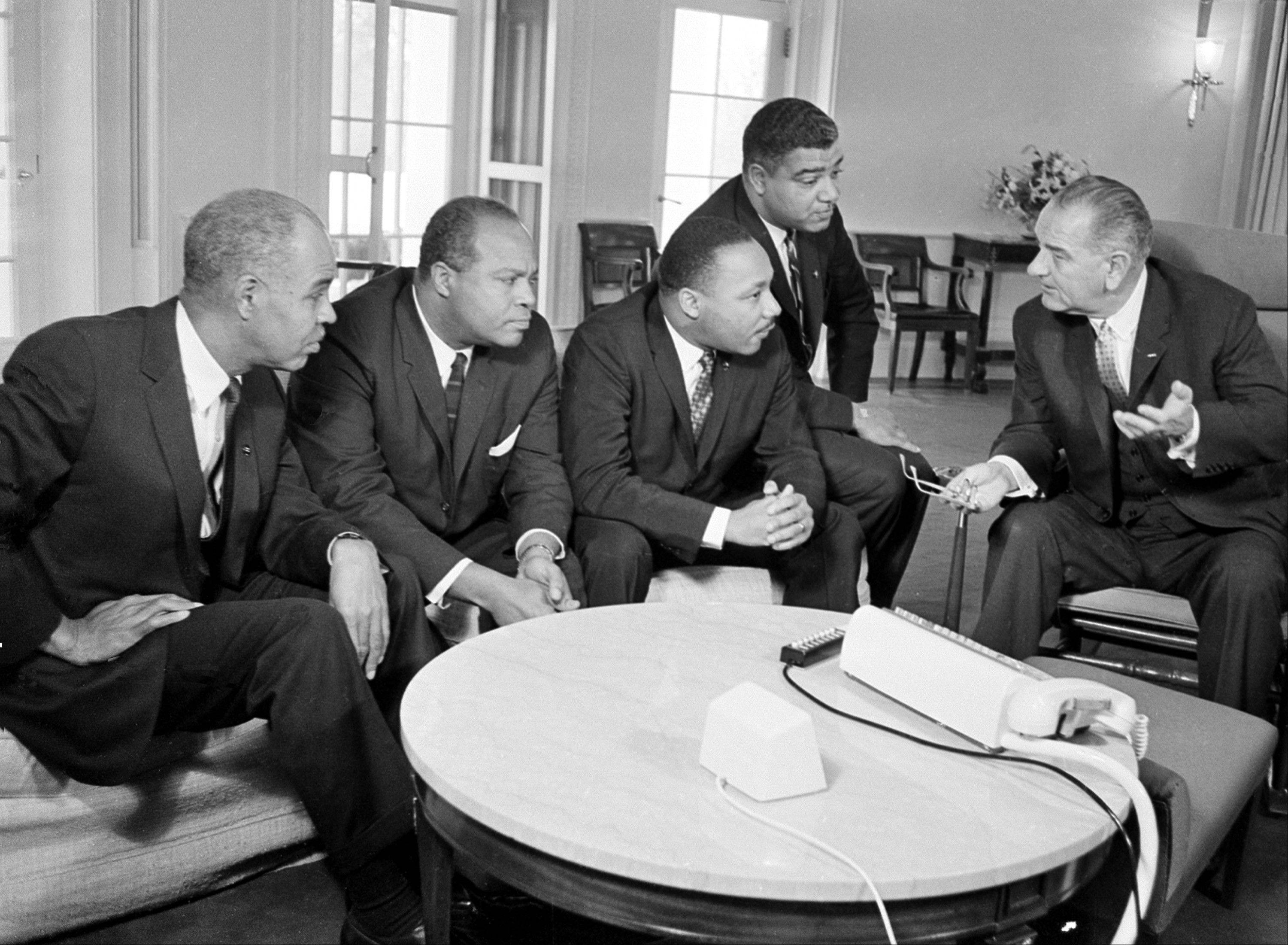 In this Jan. 18, 1964 file photo, U.S. President Lyndon B. Johnson, right, talks with civil rights leaders in his White House office in Washington, D.C. The black leaders, from left, are, Roy Wilkins, executive secretary of the National Association for the Advancement of Colored People (NAACP); James Farmer, national director of the Committee on Racial Equality; Dr. Martin Luther King Jr., head of the Southern Christian Leadership Conference; and Whitney Young, executive director of the Urban League.