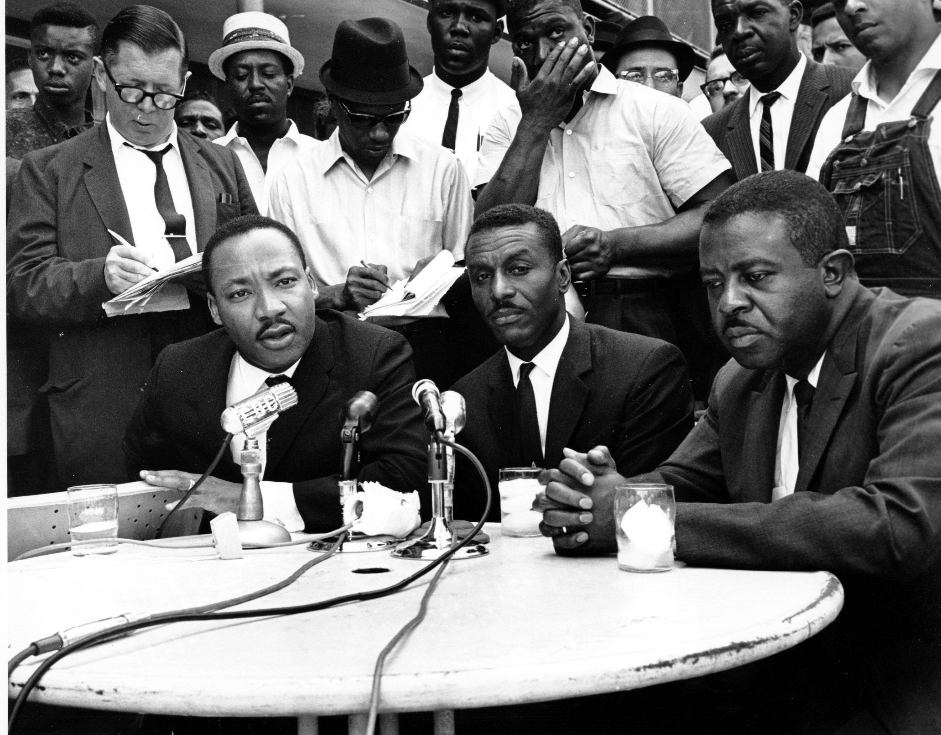In a May 8, 1963 file photo, civil rights leaders, Rev. Martin Luther King Jr., left, Rev. Fred Shuttlesworth, center, and Rev. Ralph Abernathy hold a news conference in Birmingham, Ala.