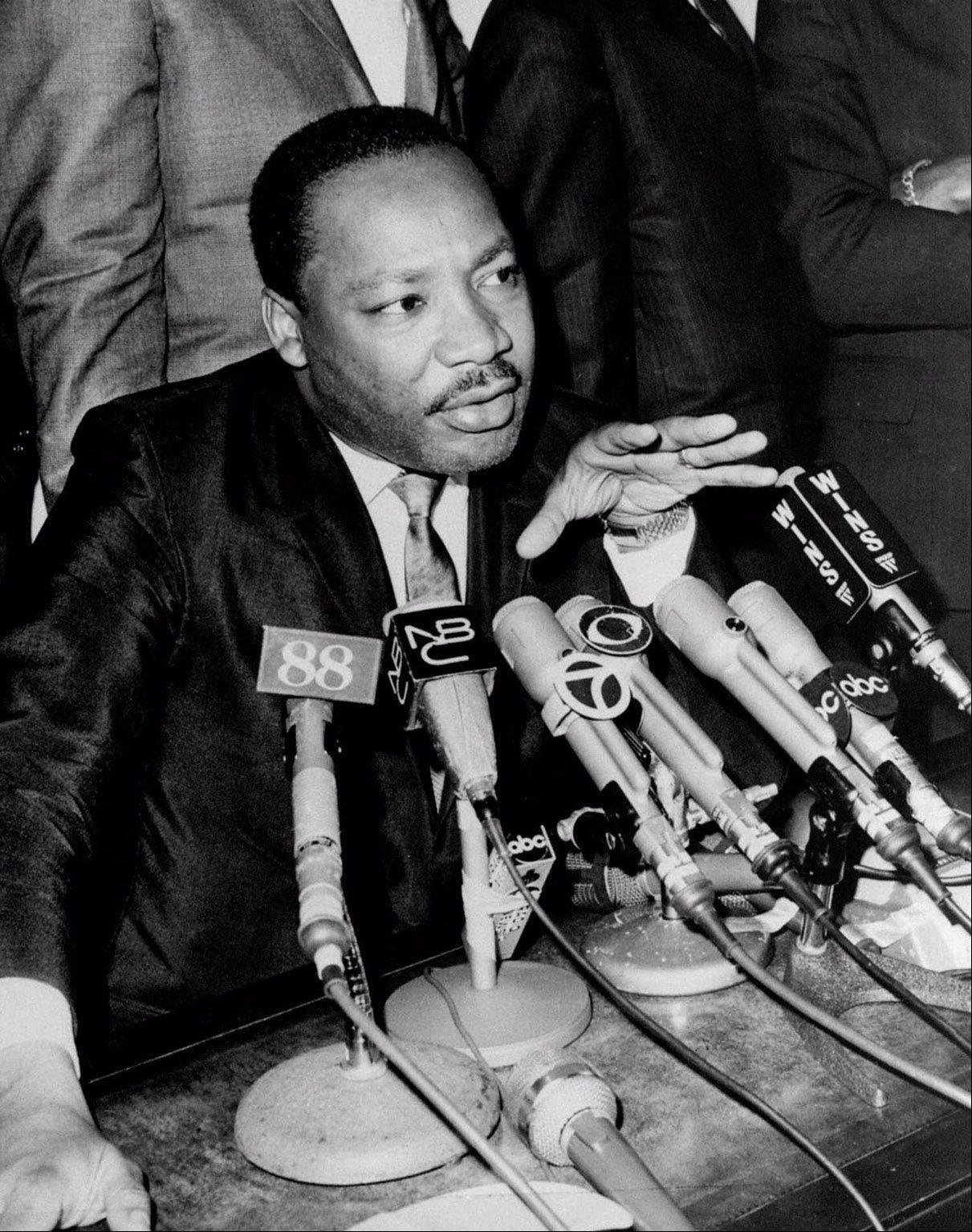 "Rev. Martin Luther King, Jr., is shown telling reporters he is ""disenchanted"" with President Johnson's Vietnam policies and may end up endorsing either Sen. Robert Kennedy or Sen. Eugene McCarthy for the 1968 Democratic Presidential nomination in this undated file photo."