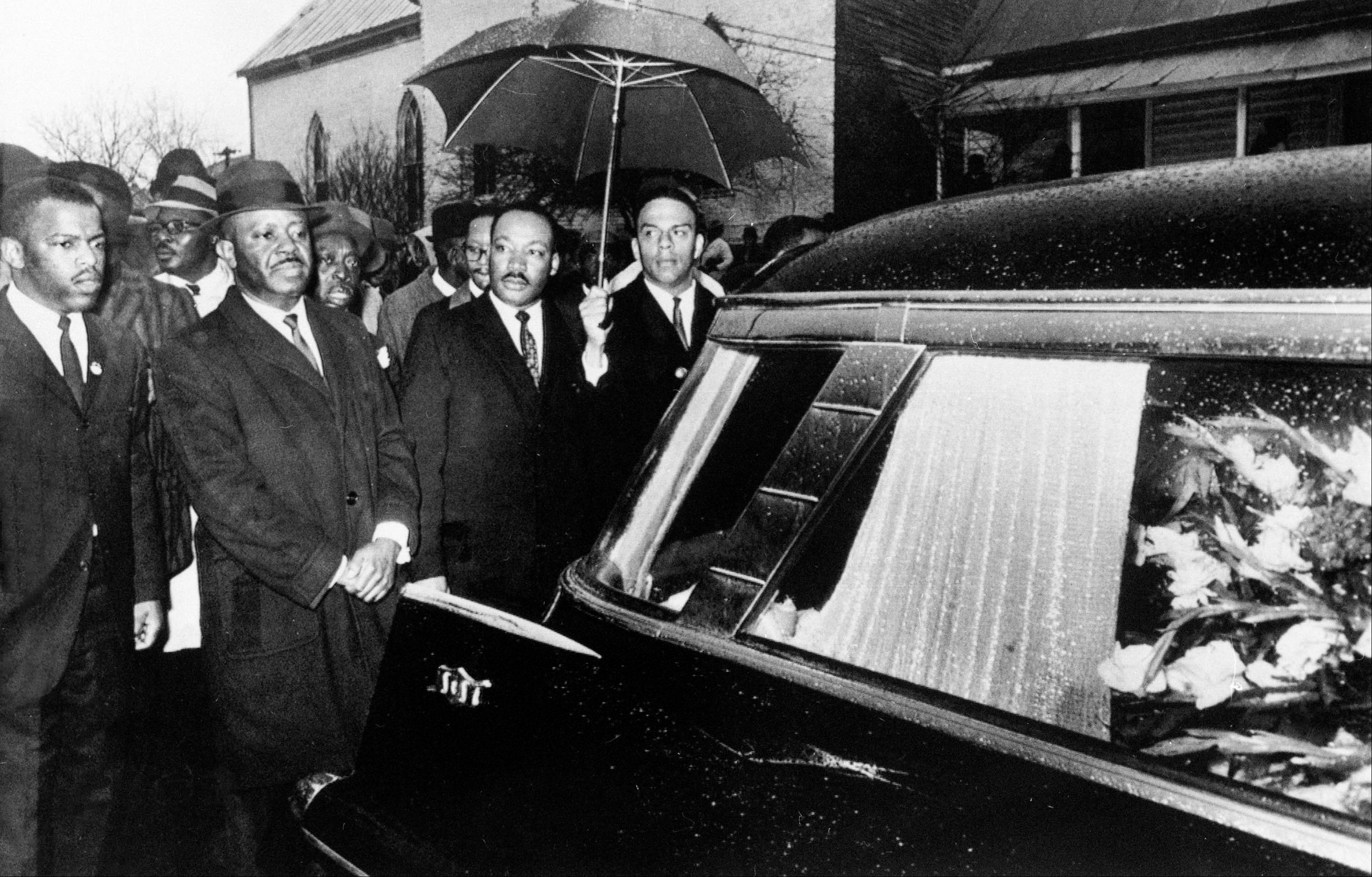 In this March 1, 1965 file photo, Dr. Martin Luther King, Jr. and associates lead a procession following the casket of Jimmy Lee Jackson during a funeral service in Marion, Ala. In November 2010, former Alabama state trooper James Bonard Fowler pleaded guilty to second-degree manslaughter in the 1965 shooting of Jimmie Lee Jackson during a civil rights demonstration in Marion.