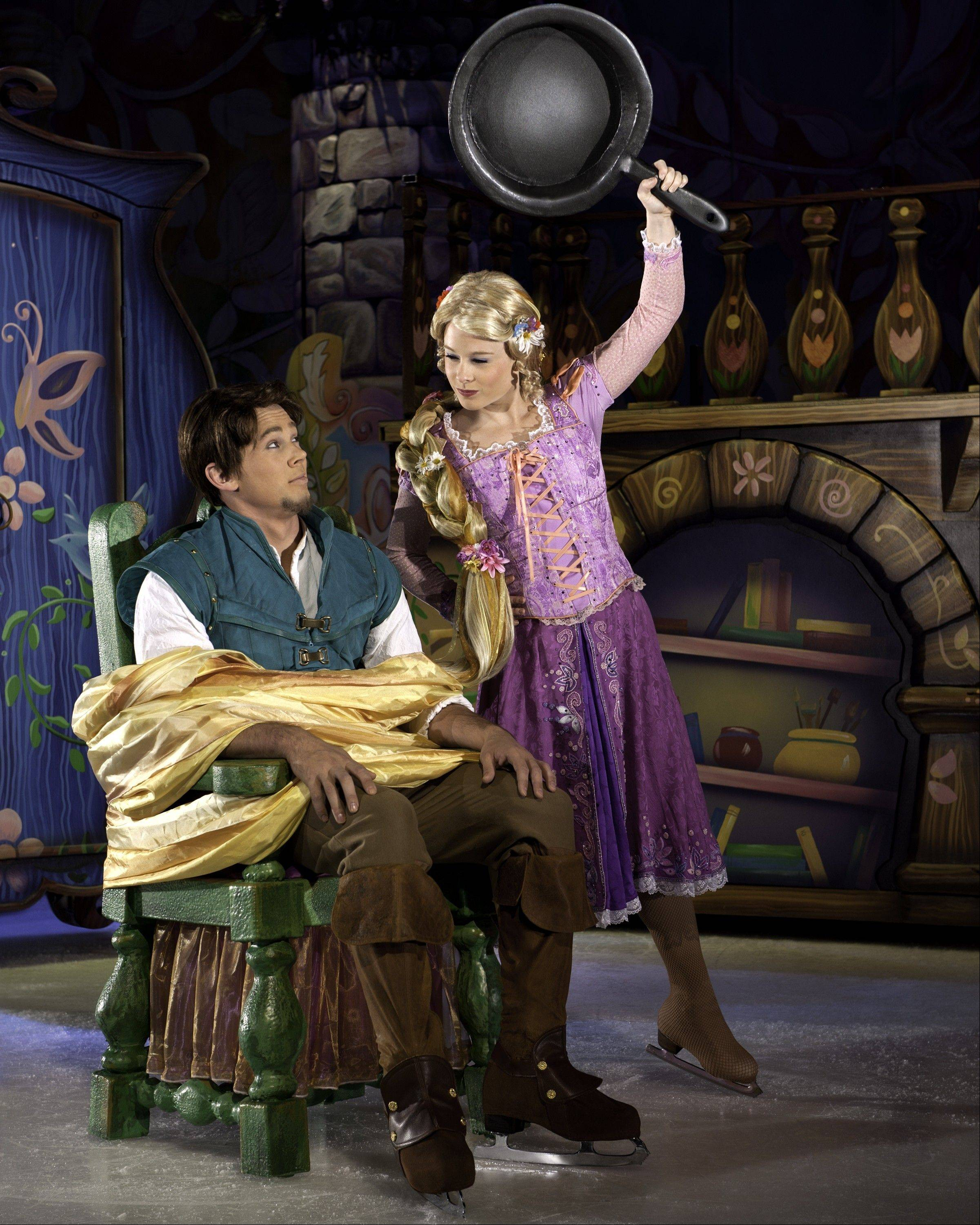 "Rapunzel threatens the thief Flynn Rider in Disney on Ice's ""Dare to Dream,"" coming to the Allstate Arena in Rosemont and the United Center in Chicago."