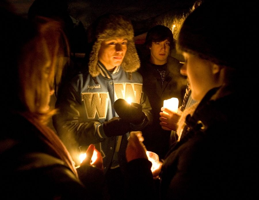 Classmates hold a vigil Tuesday night for Willowbrook High School freshman Darnell Holt, 16, and three of his relatives.