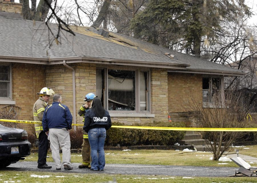 Investigators from the DuPage County sheriff's office, the Bureau of Alcohol, Tobacco, Firearms and Explosives out of Joliet and local fire departments investigate the scene where four people were shot then burned in a house fire Tuesday morning in unincorporated DuPage County between Oakbrook Terrace and Villa Park. Authorities said they believe the man who shot the victims and set the fire later committed suicide.