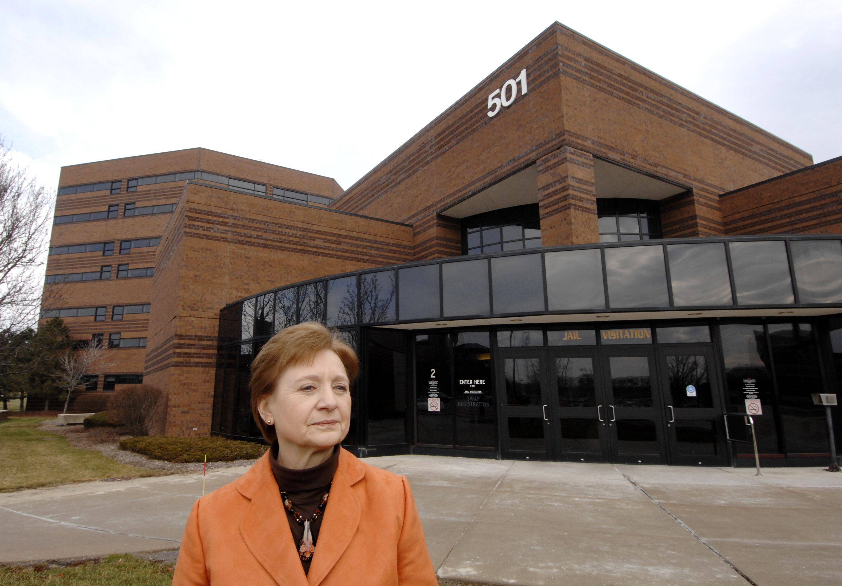 Susan Neustrom stands in front of the DuPage County jail, where JUST has an office to offer education classes, addiction recovery programs and spiritual support to inmates.