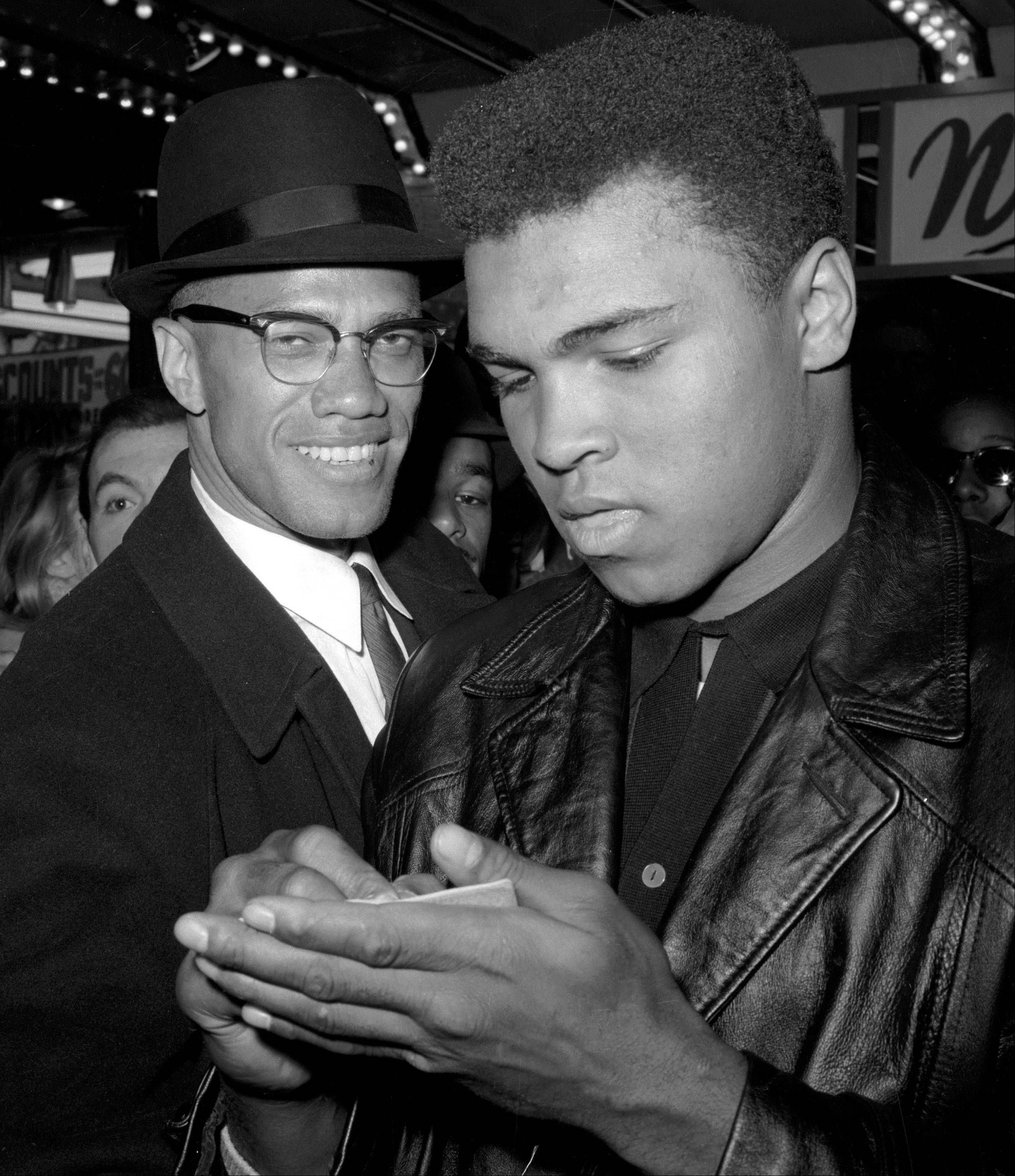 Heavyweight boxing champion Muhammad Ali, right, is shown with black Muslim leader Malcolm X in New York, after viewing the screening of a film about Ali's title fight with Sonny Liston.
