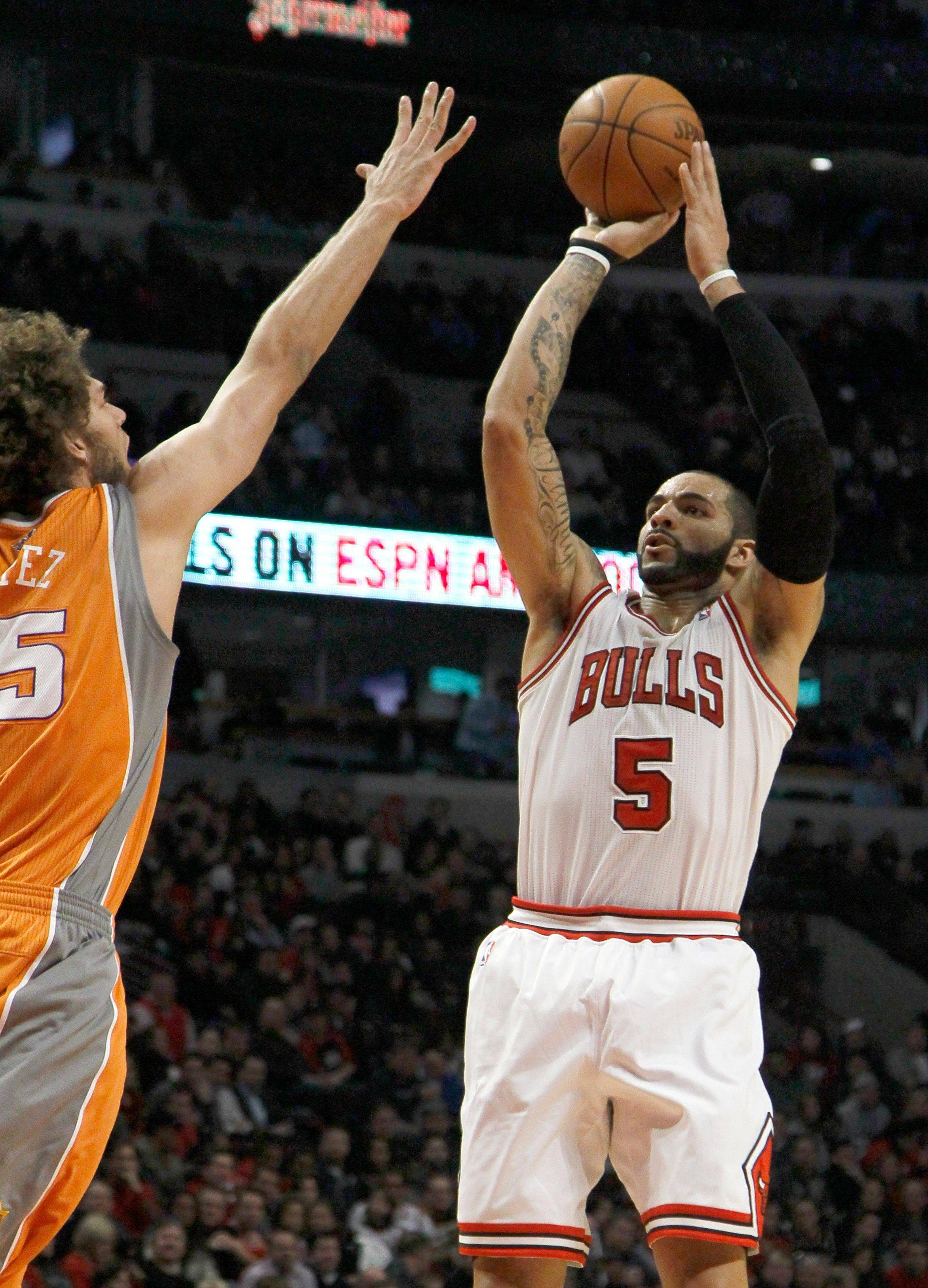 Bulls forward Carlos Boozer shoots over Phoenix Suns center Robin Lopez during the first half Tuesday night. Boozer led the Bulls with a season-high 31 points.