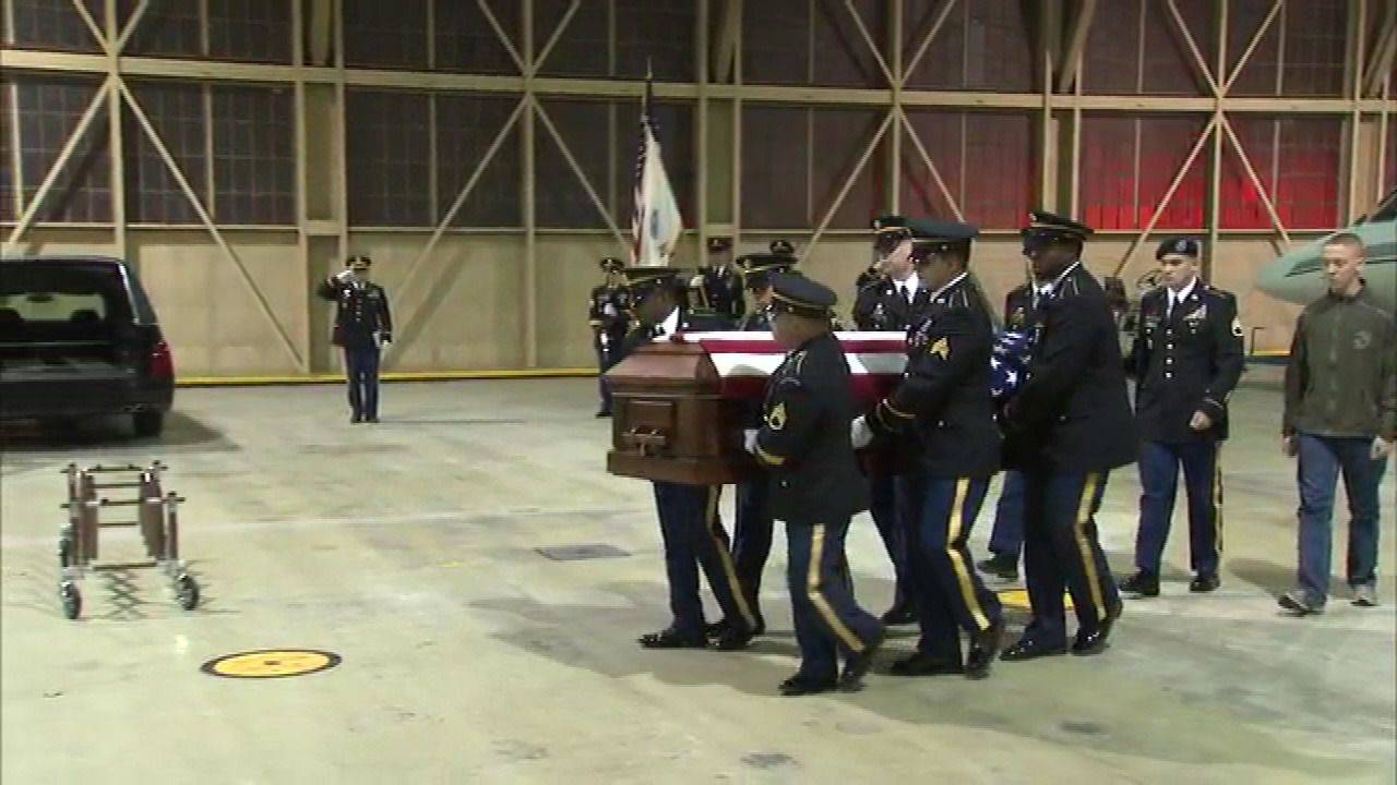 The remains of Spc. Christopher A. Patterson of North Aurora arrive at Midway Airport Wednesday evening. Patterson was killed Jan. 6 in an explosion in Afghanistan.