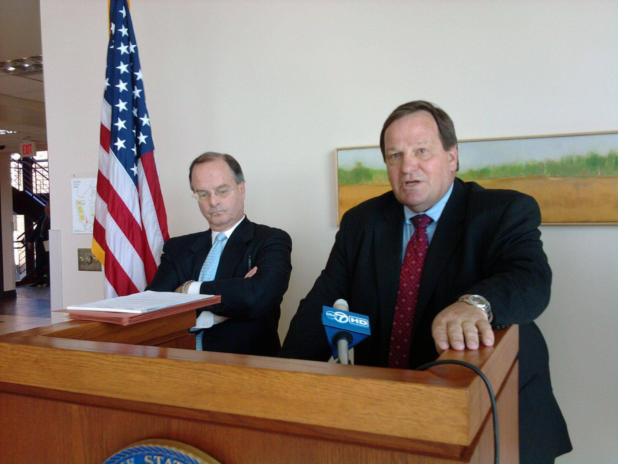 Special Prosecutors Thomas McQueen, left, and Henry Tonigan announce new misconduct charges against McHenry County State's Attorney Louis Bianchi in Woodstock today. Bianchi and others in his office are accused of using their positions of power for lighter or reduced sentences for relatives and contributors to Bianchi's campaign.