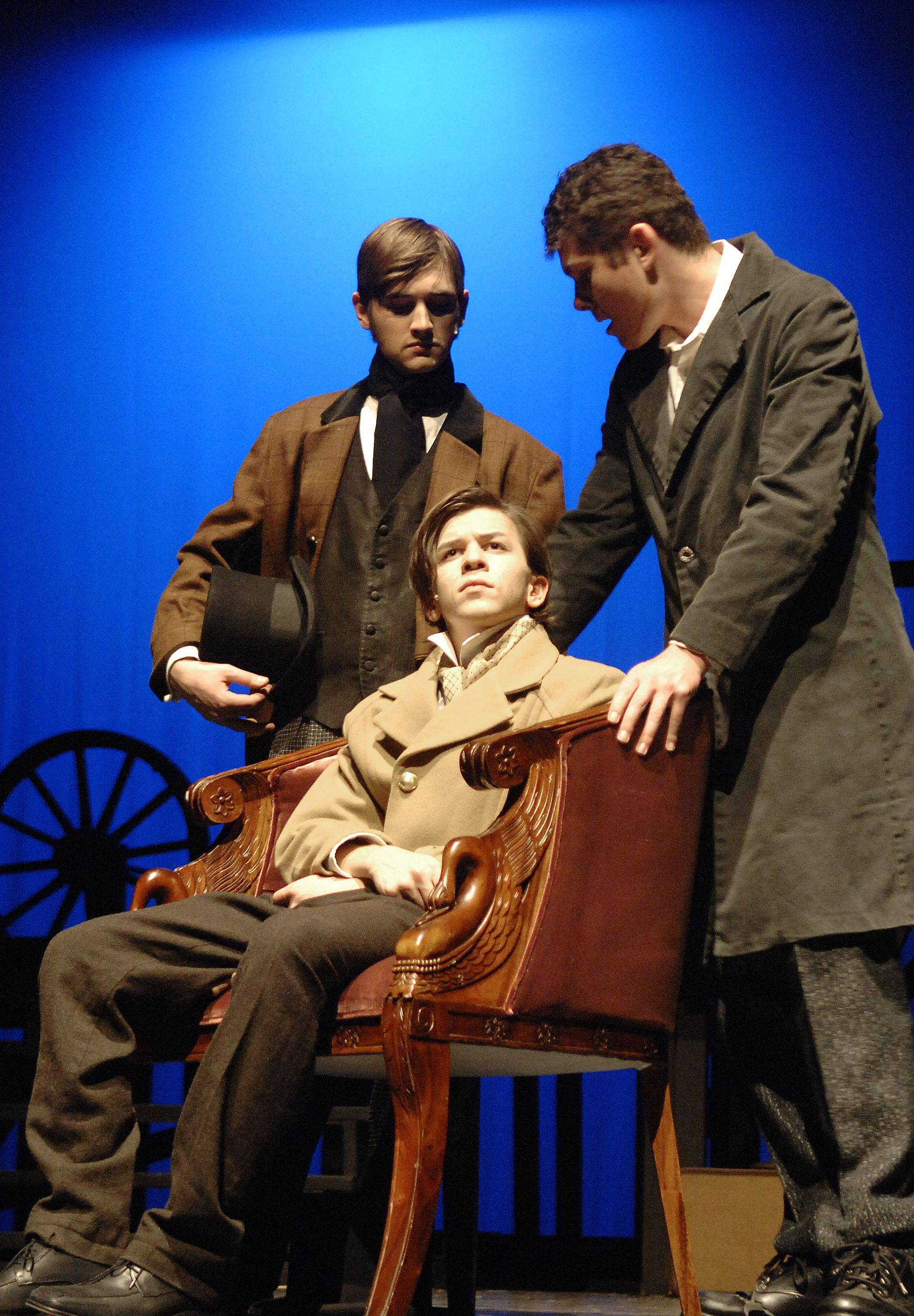 "During a scene in act II, senior Charles Grimse, seated, plays the role of Pip; sophomore Jeff Heise portrays Herbert, left; and sophomore Andrew Tucker plays Magwitch, right, in Batavia High School's production of Charles Dickens' ""Great Expectations."""