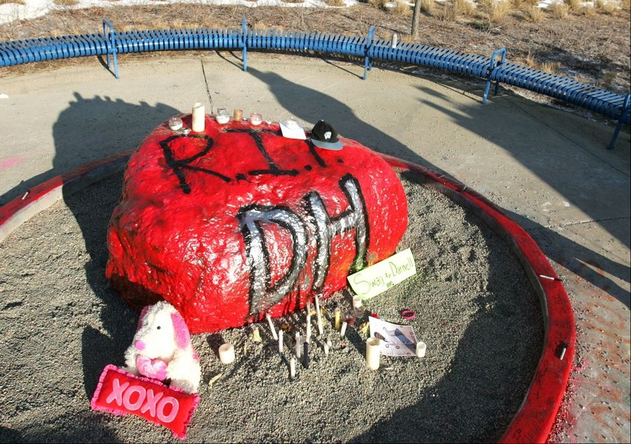 The Rock, a symbol of the Willowbrook High School Warrior tradition, was painted red overnight in honor of slain freshman Darnell Holt, who loved the color.
