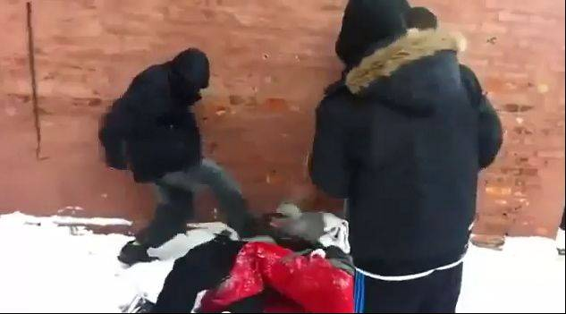 This frame-grab from an online video shows the beating of a young Asian male by a group of teens in Chicago.