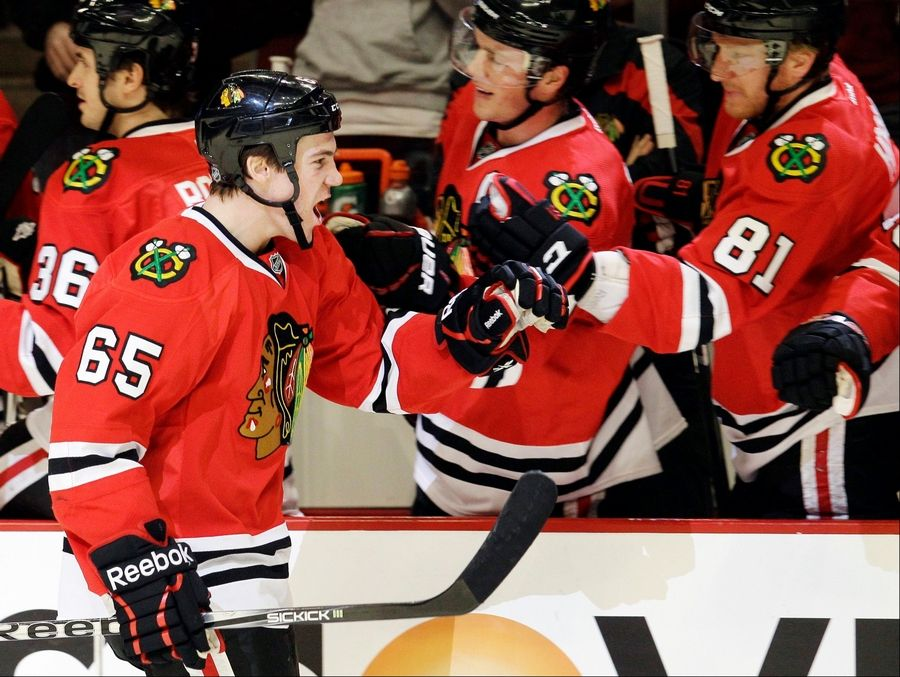 Chicago Blackhawks' Andrew Shaw (65) celebrates Wednesday with teammates after scoring his goal during the first period.