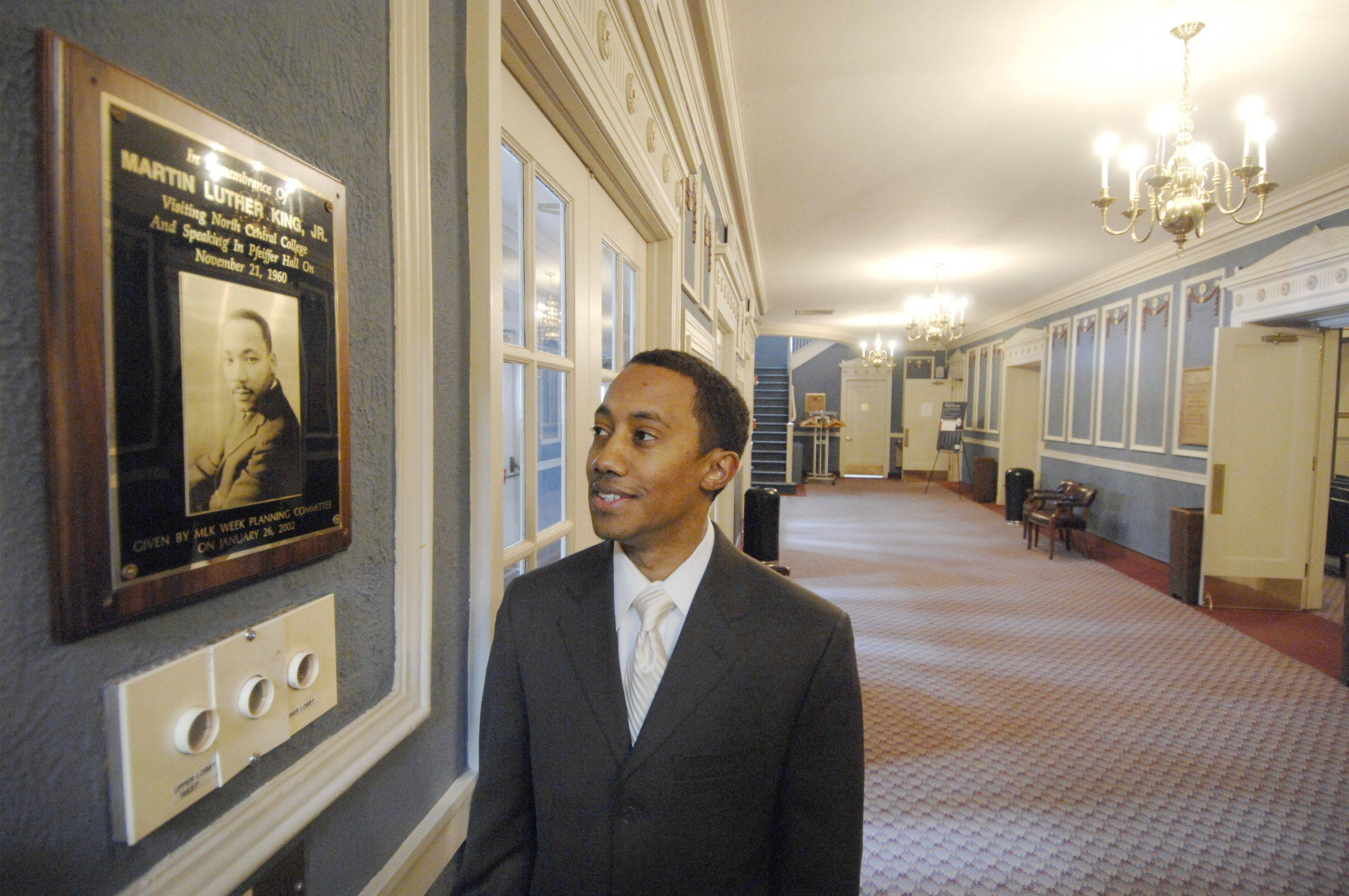 DuPage County NAACP President Mario Lambert examines a plaque of Martin Luther King displayed in the lobby of Pfeiffer Hall at North Central College in Naperville. It commemorates a speech King gave there in 1960.