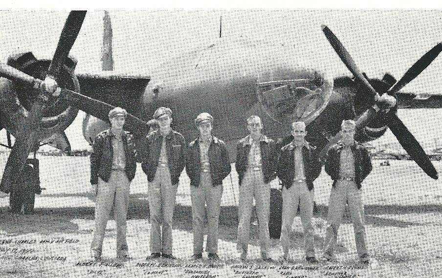 Albert J. Allen, left, a former employee of the Elgin National Watch Co., is shown in a company publication with the crew of a B-17 of which he was the pilot.