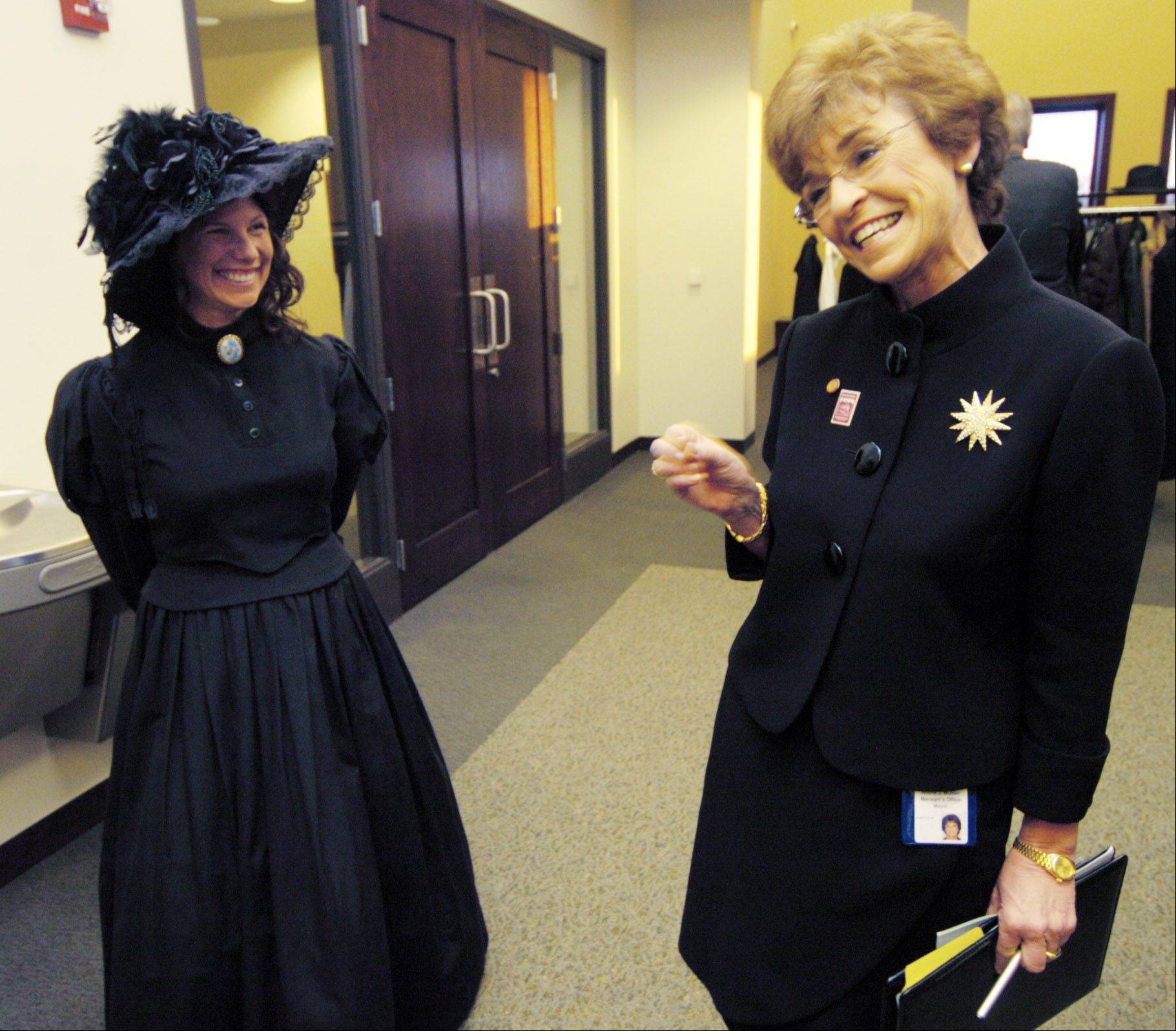Dawn Walter, left, a volunteer at the Arlington Heights Historical Museum, shows Village President Arlene Mulder her 1880s outfit.