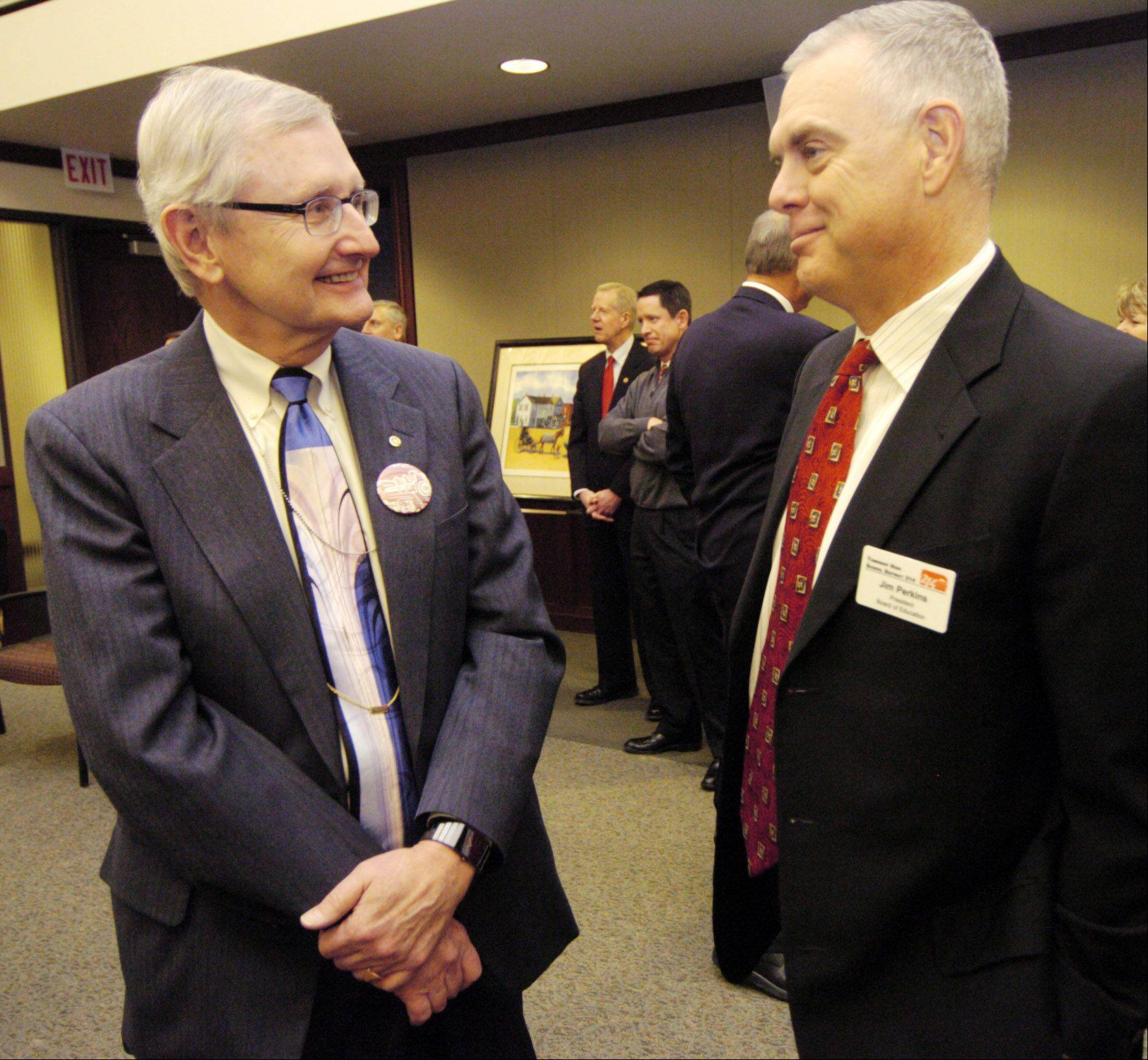 Bob Paddock, executive vice president of the Daily Herald, talks with Jim Perkins, president of the board of Northwest Suburban High School District 214, during the celebration of the 125th anniversary of Arlington Heights' incorporation.