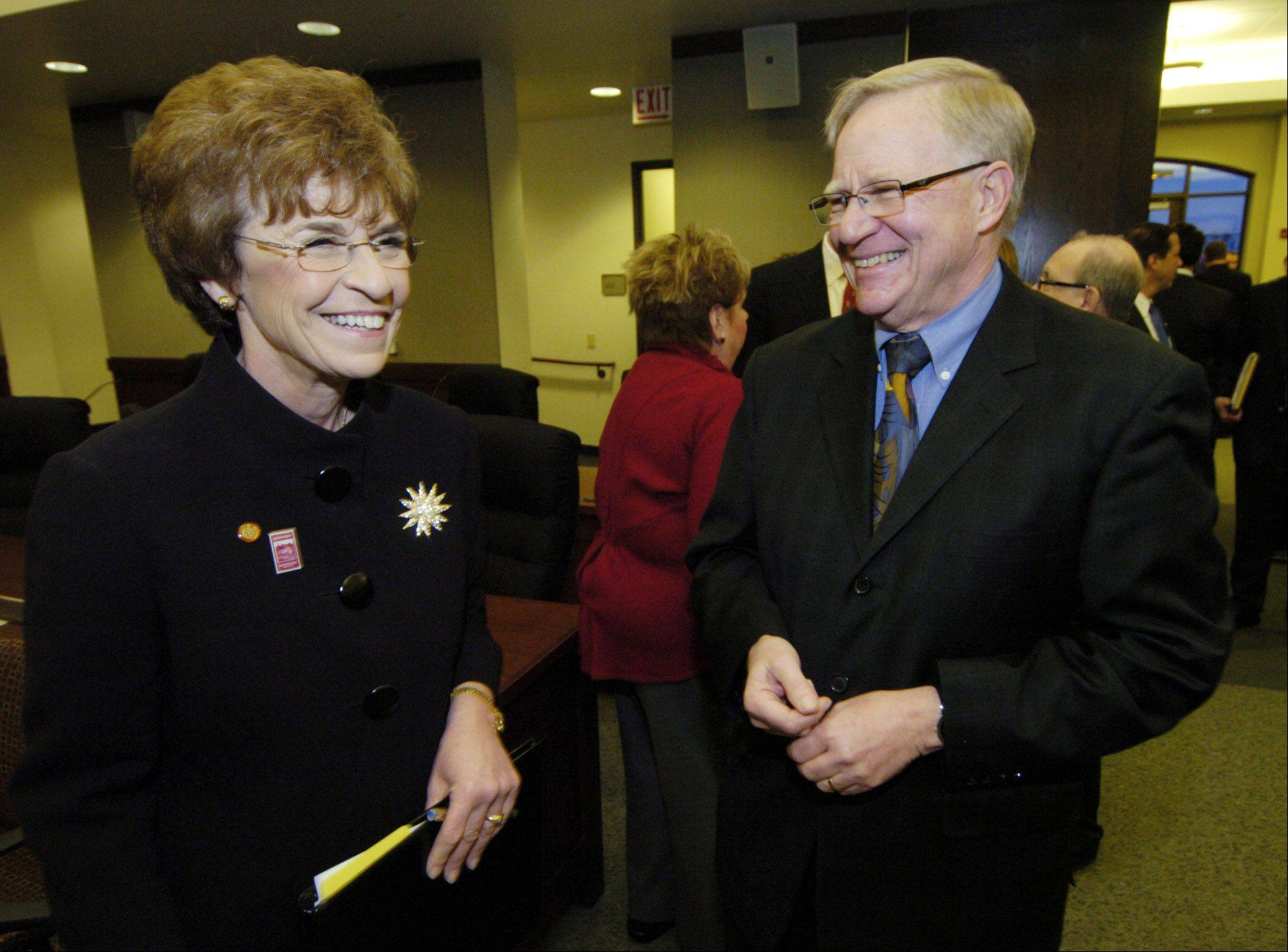 Arlington Heights Village President Arlene Mulder, left, greets William Maki, former village president and current presiding judge of the Third Municipal Court in Rolling Meadows. Maki purchased a banner to mark the Quasquicentennial, Mulder said.