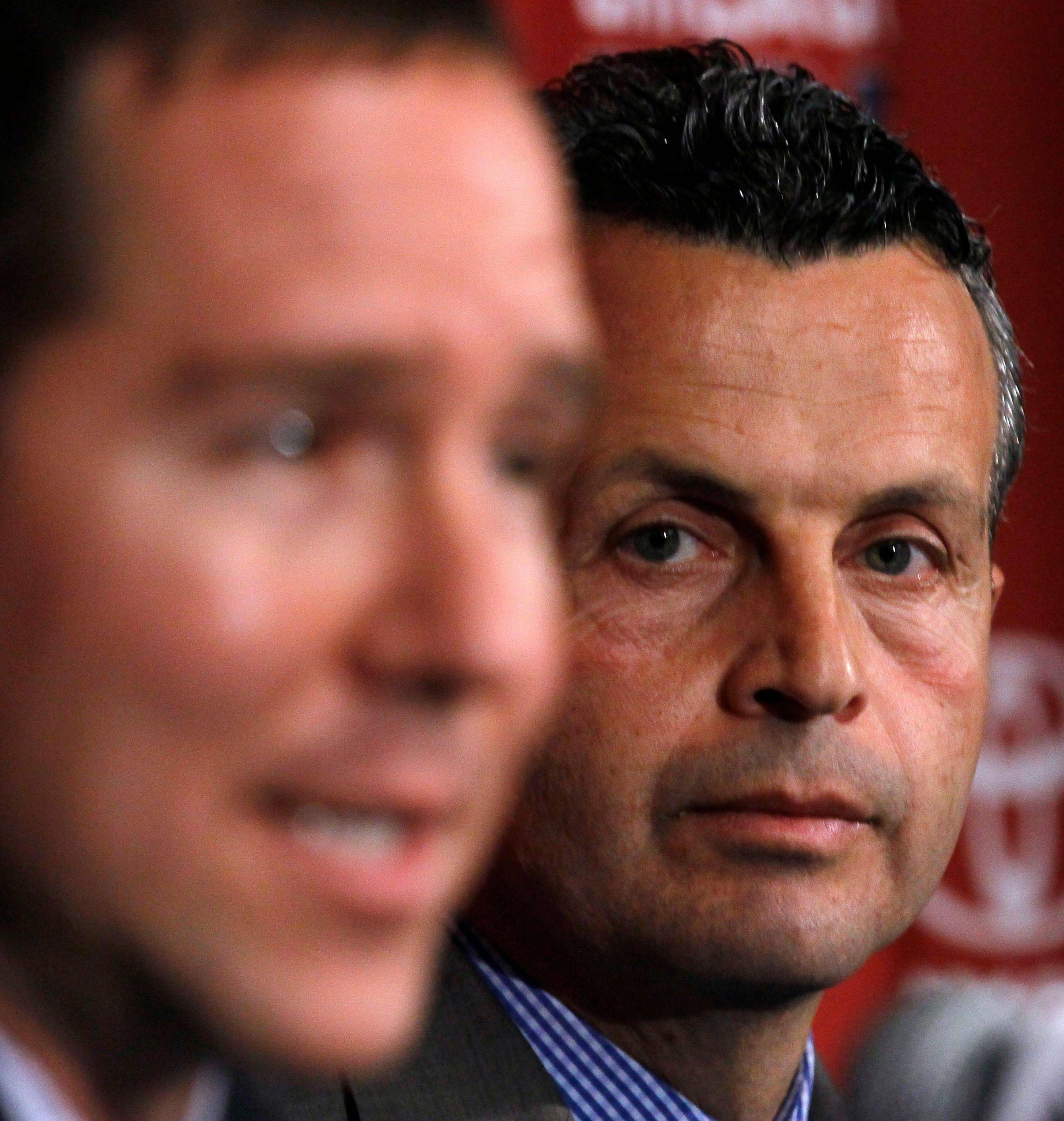 "Frank Klopas, right, listens as Chicago Fire owner Andrew Hauptman speaks after naming Klopas the new head coach of the soccer team during a news conference on Nov. 3. On Thursday, Hauptman said ""the expectations are high"" for the 2012 season."