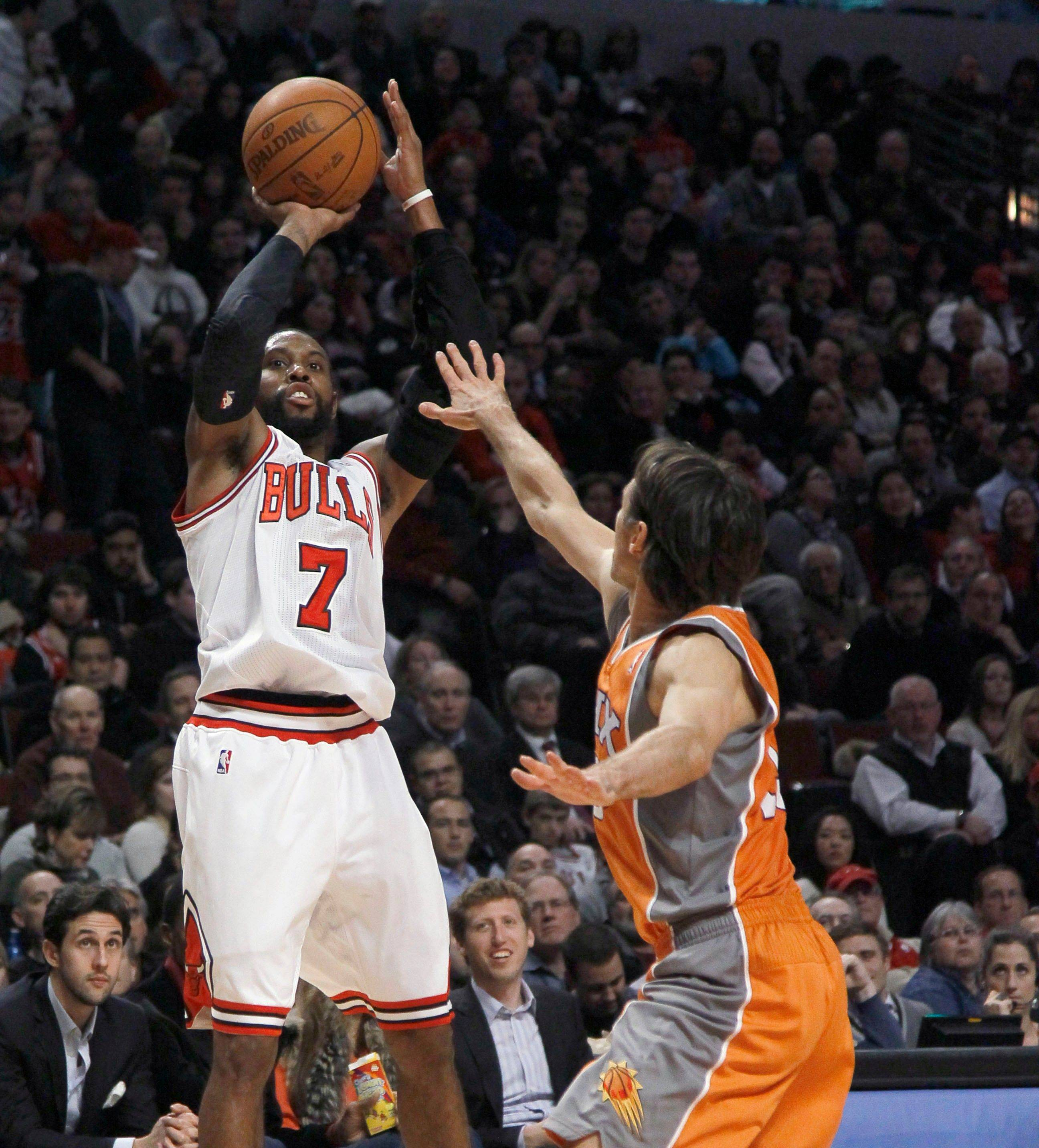 The Bulls' C.J. Watson fires in 2 of his 23 points against the Suns on Tuesday at the United Center. The Bulls won 118-97 and are on the road tonight at Cleveland.