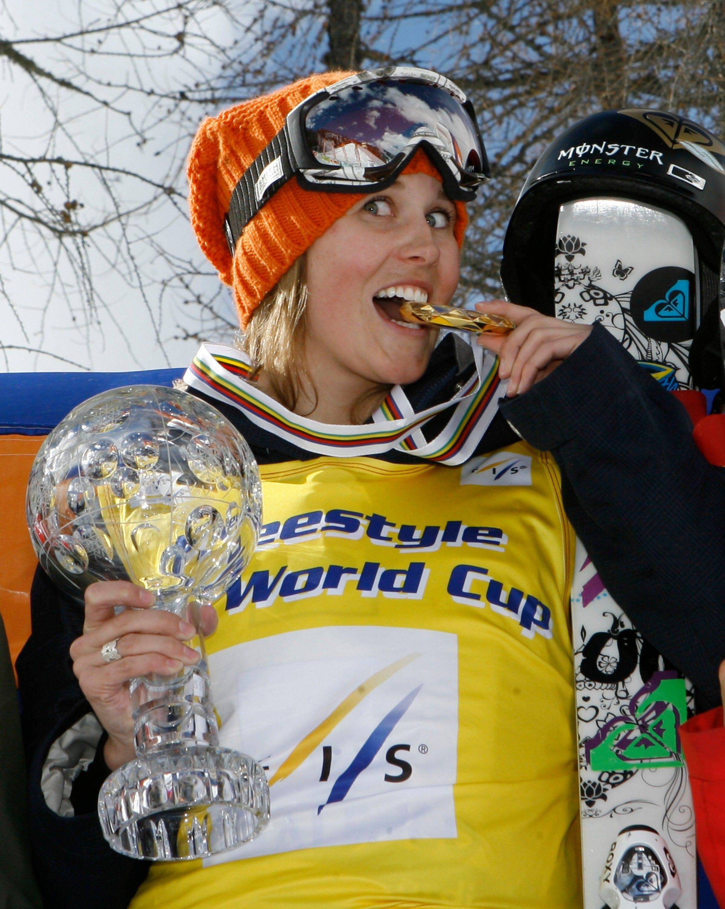 Sarah Burke celebrates on the podium after winning the women's half-pipe freestyle title at the World Cup finals in Valmalenco, Italy. Burke died Thursday, nine days after crashing at the bottom of the superpipe during a training run in Utah. She was 29. Burke was injured Jan. 11 while training at a personal sponsor event at the Park City Mountain resort.