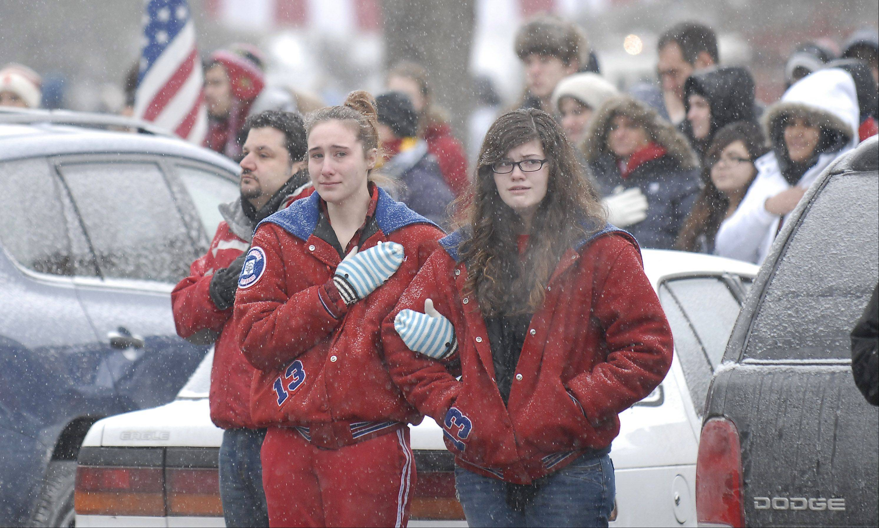 Students from West Aurora High School pay their respects to Spc. Christopher A. Patterson of North Aurora as the hearse carrying his body drives past the school Friday morning. Patterson, who graduated in 2009 from West High, was killed Jan. 6 in Afghanistan.