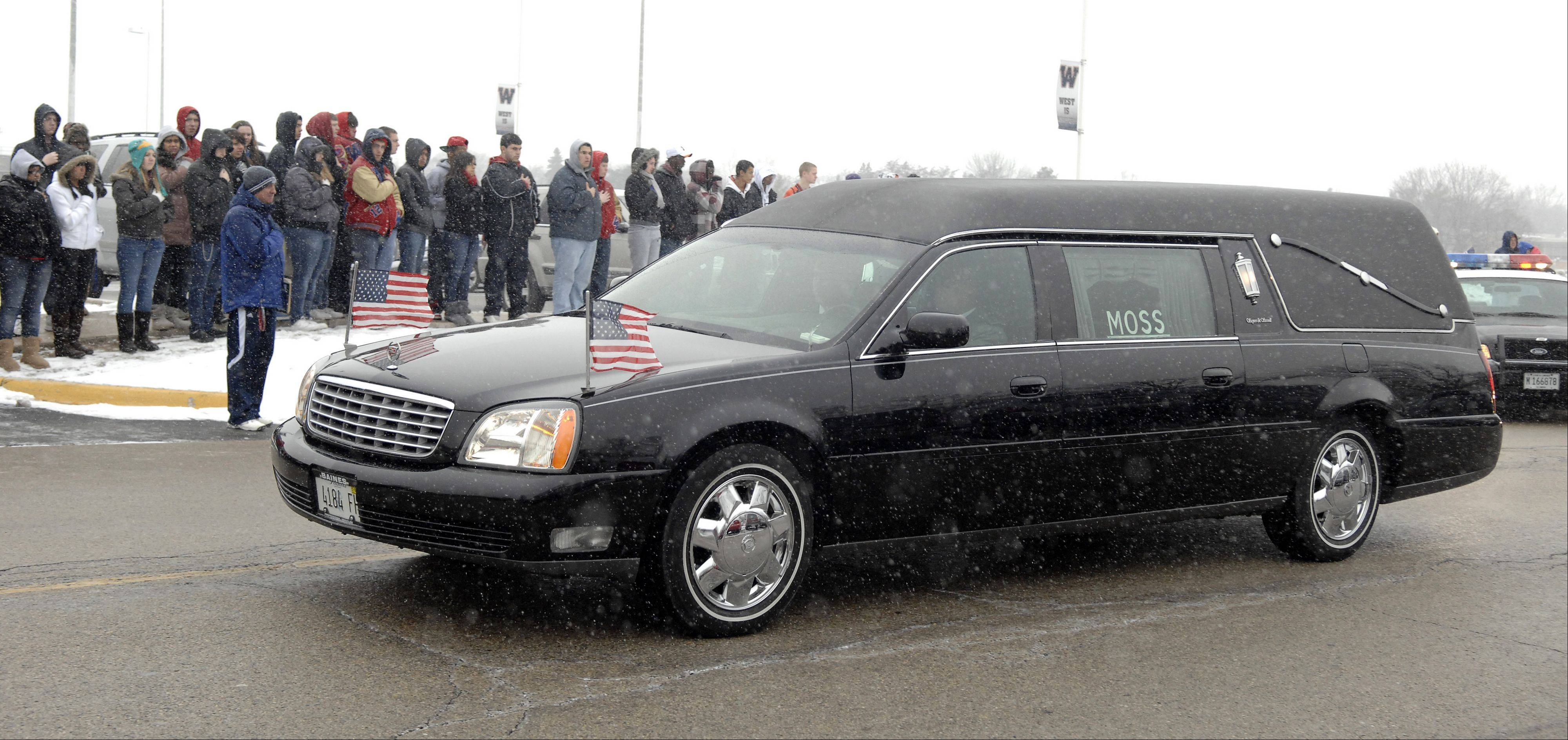 Students from West Aurora High School pay their respects to Spc. Christopher A. Patterson as his funeral procession passes his former school on Friday, January 20. Patterson, a 2009 graduate, was killed on January 6.