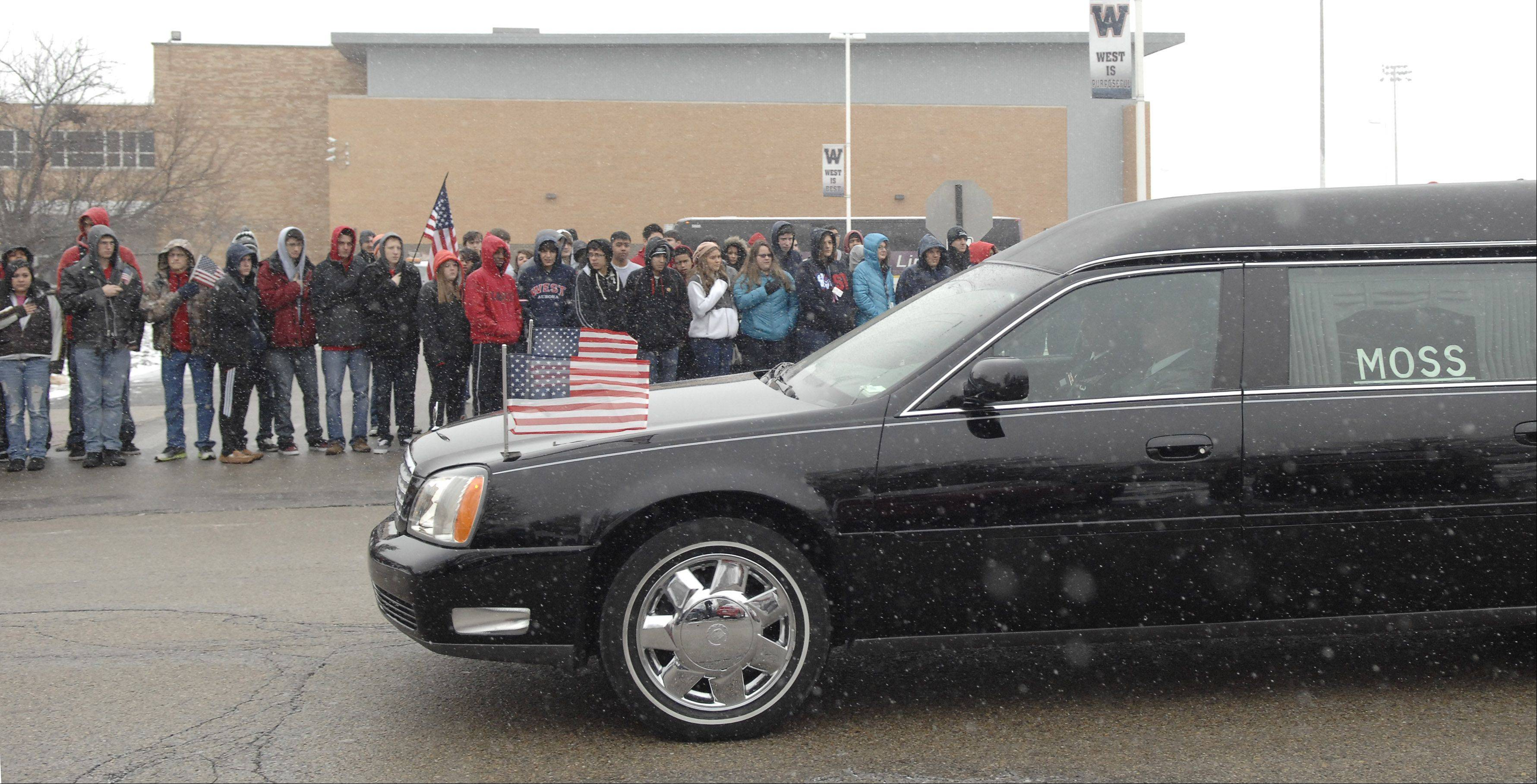 Students from West Aurora High School pay their respects to Spc. Christopher A. Patterson as his funeral procession passes his former school on Friday, January 20. Patterson, a 2009 grad, was killed on January 6.