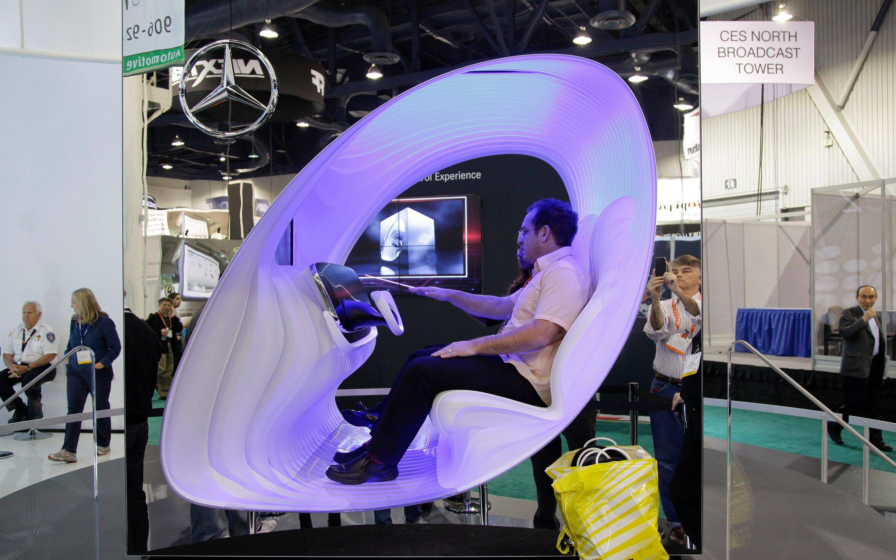 An industry affiliate tests out the Mercedes Dynamic and Intuitive Control Experience at the 2012 International Consumer Electronics show.