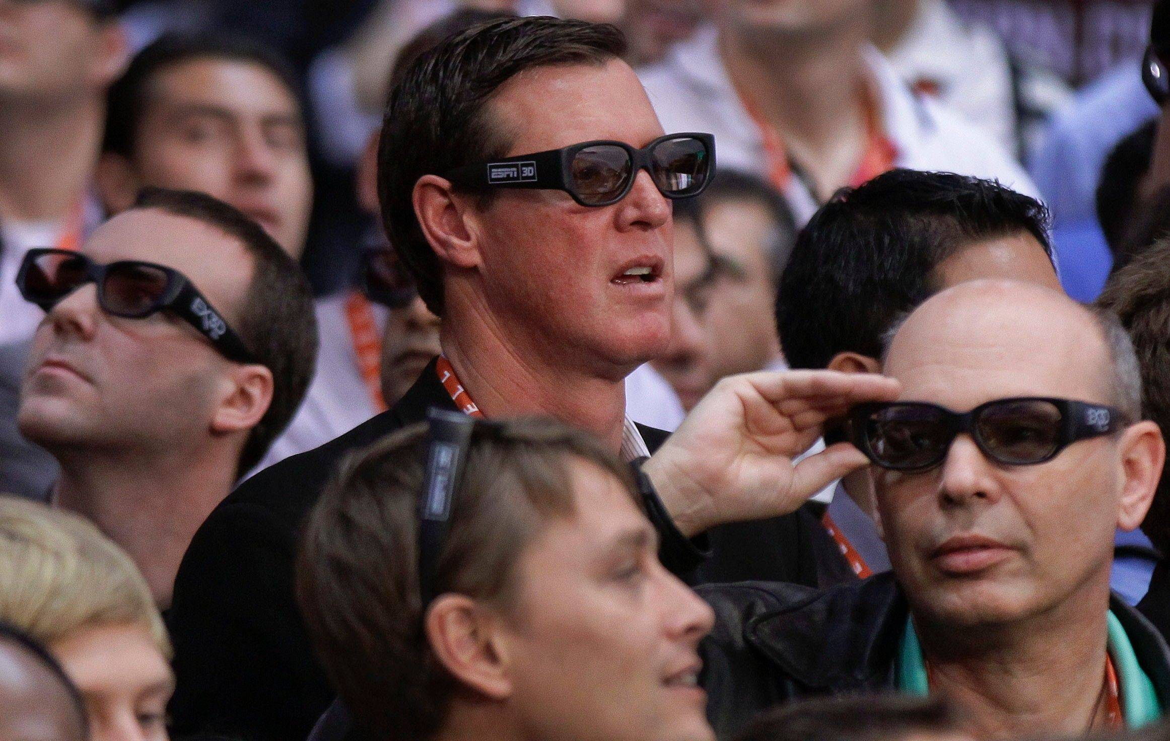 Spectators watch replays of live boxing by ESPN in 3-D at the 2012 International Consumer Electronics Show,